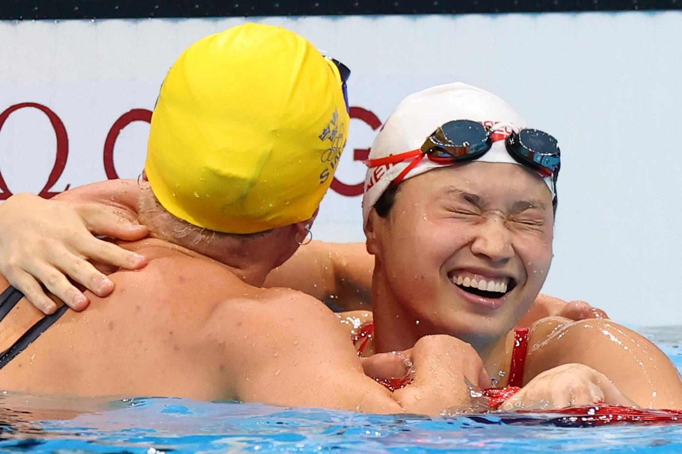 Tokyo 2020 Olympics - Swimming - Women's 100m Butterfly - Final - Tokyo Aquatics Centre - Tokyo, Japan - July 26, 2021. Margaret MacNeil of Canada celebrates after winning the gold medal. REUTERS/Marko Djurica - SP1EH7Q04TYI5