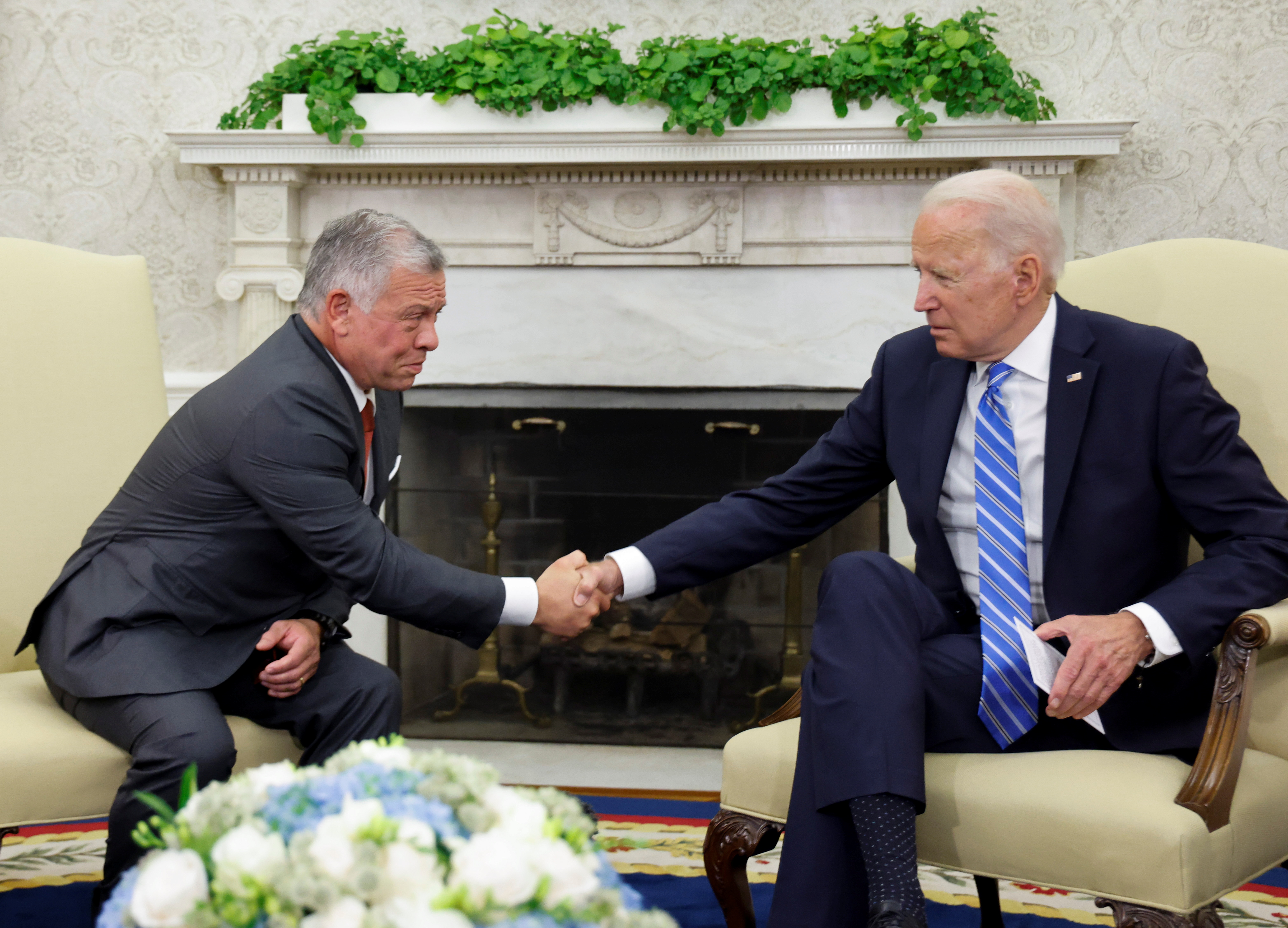 U.S. President Joe Biden shakes hands with Jordan's King Abdullah II in the Oval Office at the White House in Washington, U.S. July 19, 2021. REUTERS/Jonathan Ernst