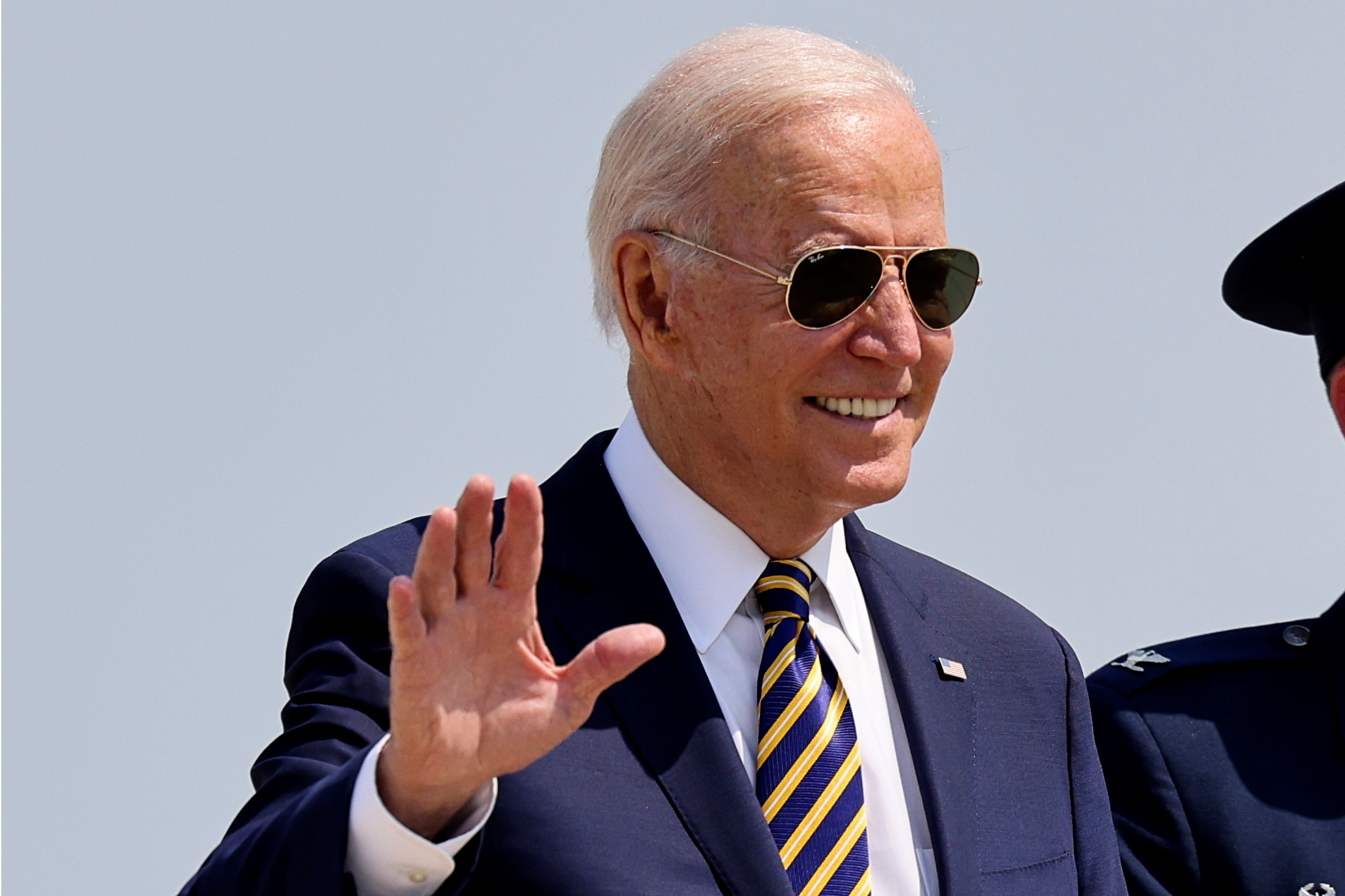 U.S. President Joe Biden waves while boarding Air Force One as he departs Washington for travel to Pennsylvania at Joint Base Andrews, Maryland, U.S., July 28, 2021. REUTERS/Evelyn Hockstein