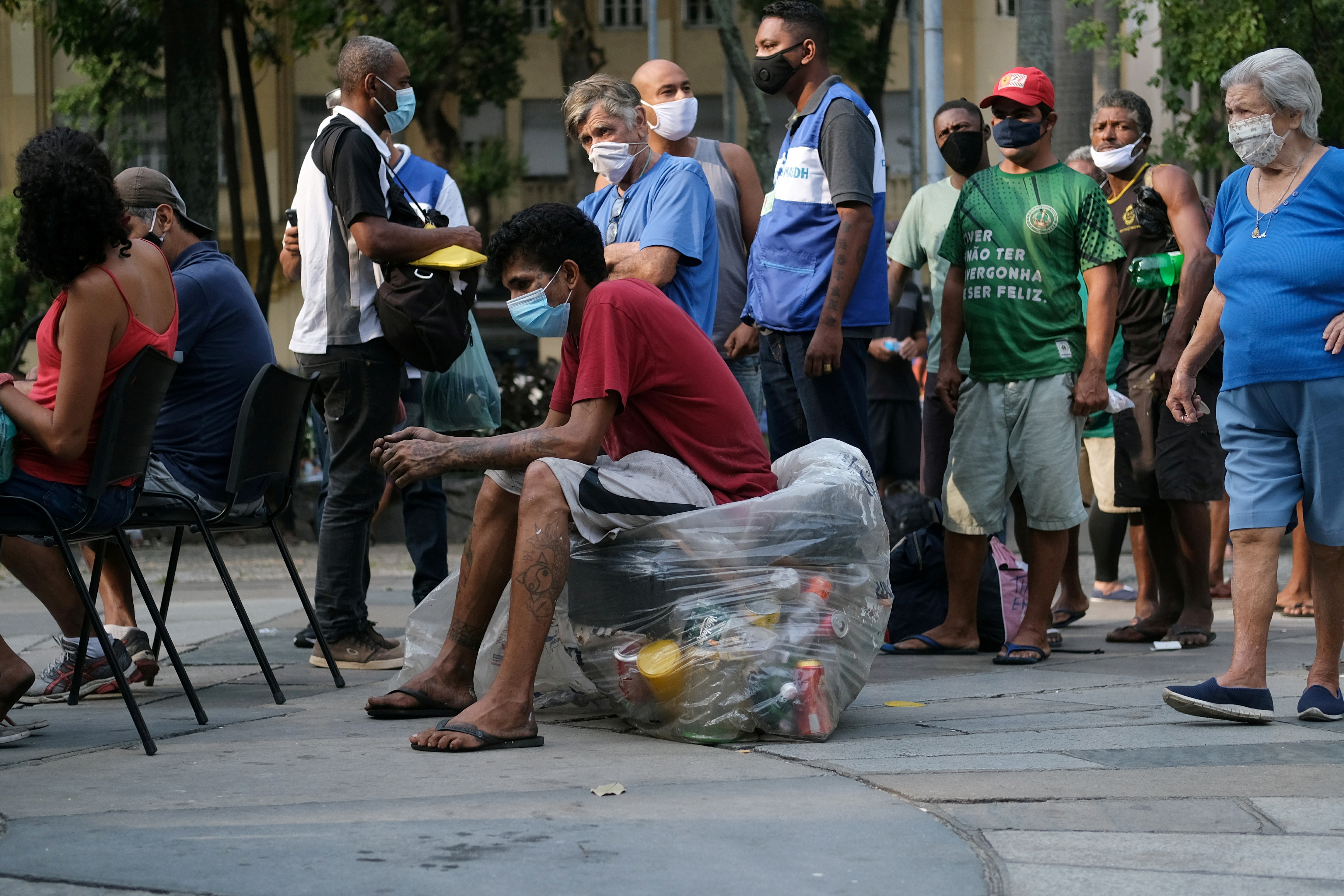 People wait to receive an AstraZeneca coronavirus disease (COVID-19) vaccine during a vaccination campaign for homeless people, in Rio de Janeiro's downtown, Brazil, May 27, 2021. REUTERS/Ricardo Moraes