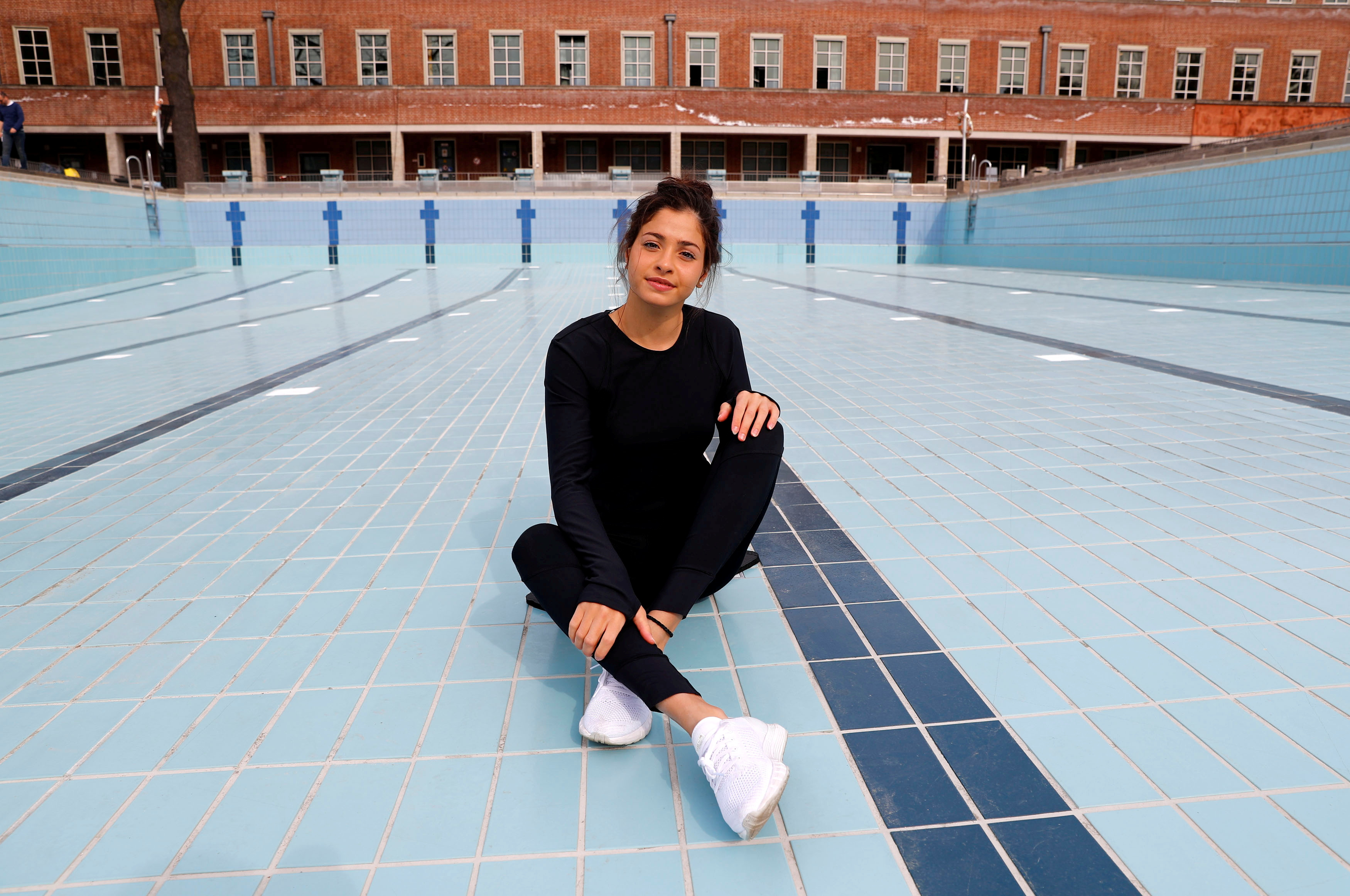 Syrian refugee and Olympic swimmer Yusra Mardini poses after a training session in a pool at the Olympic park in Berlin, Germany, April 12, 2018.   REUTERS/Fabrizio Bensch