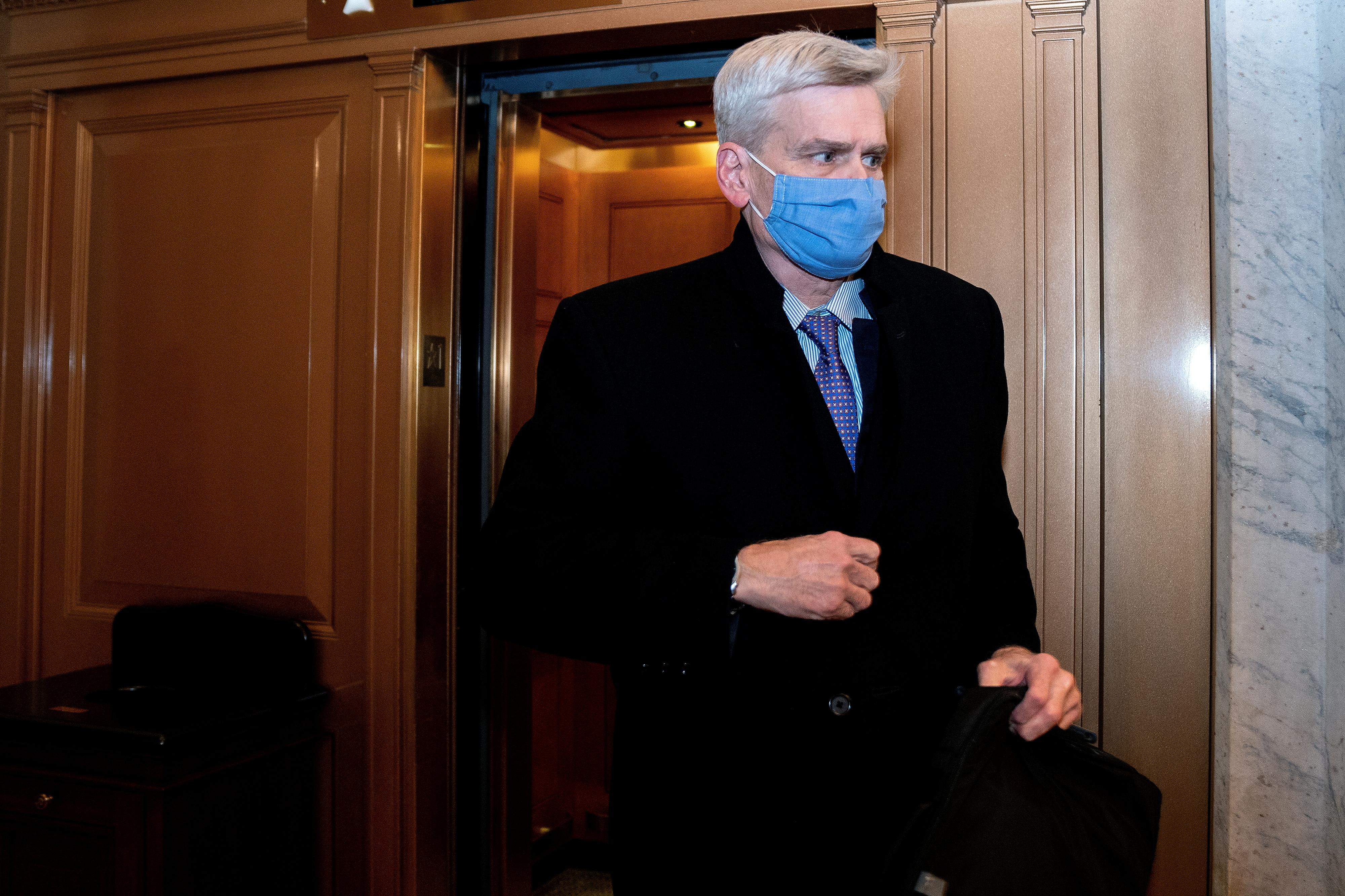 U.S. Senator Bill Cassidy (R-LA) wears a protective mask while departing the U.S. Capitol in Washington, U.S., February 13, 2021. Stefani Reynolds/Pool via REUTERS