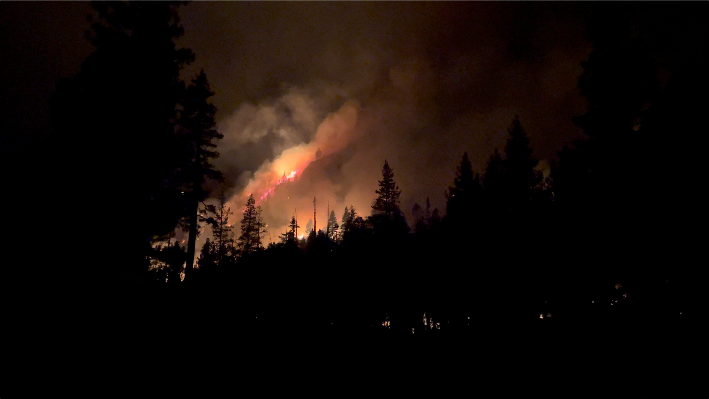 Smoke and flames are seen amid an early morning wildfire in South Lake Tahoe, California, U.S. August 31, 2021, in this still image from video obtained via social media. Nicholas Vides/The Oak Leaf via REUTERS