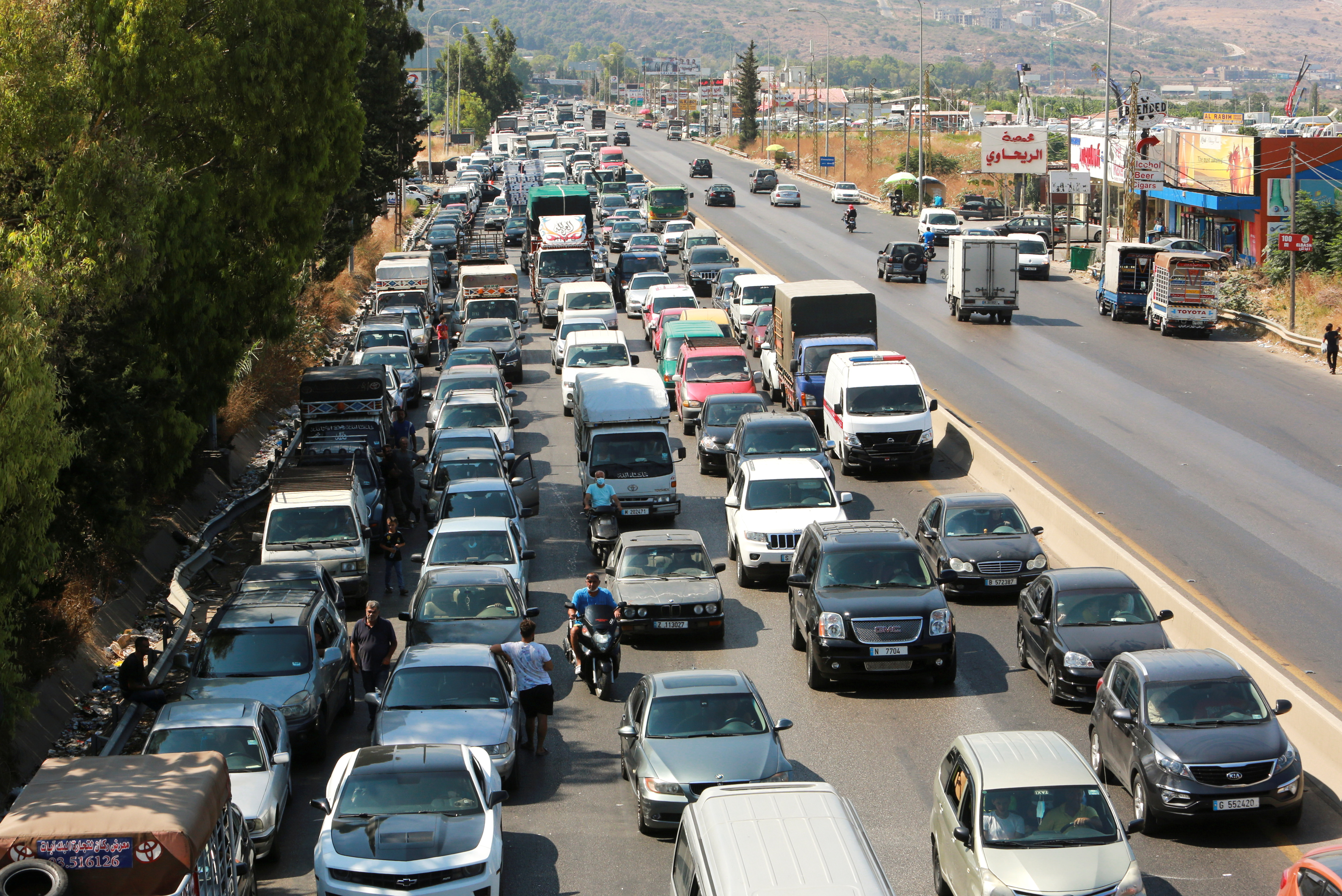 A view shows cars stuck in a traffic jam near a gas station in Jiyeh, Lebanon, August 13, 2021. REUTERS/Aziz Taher