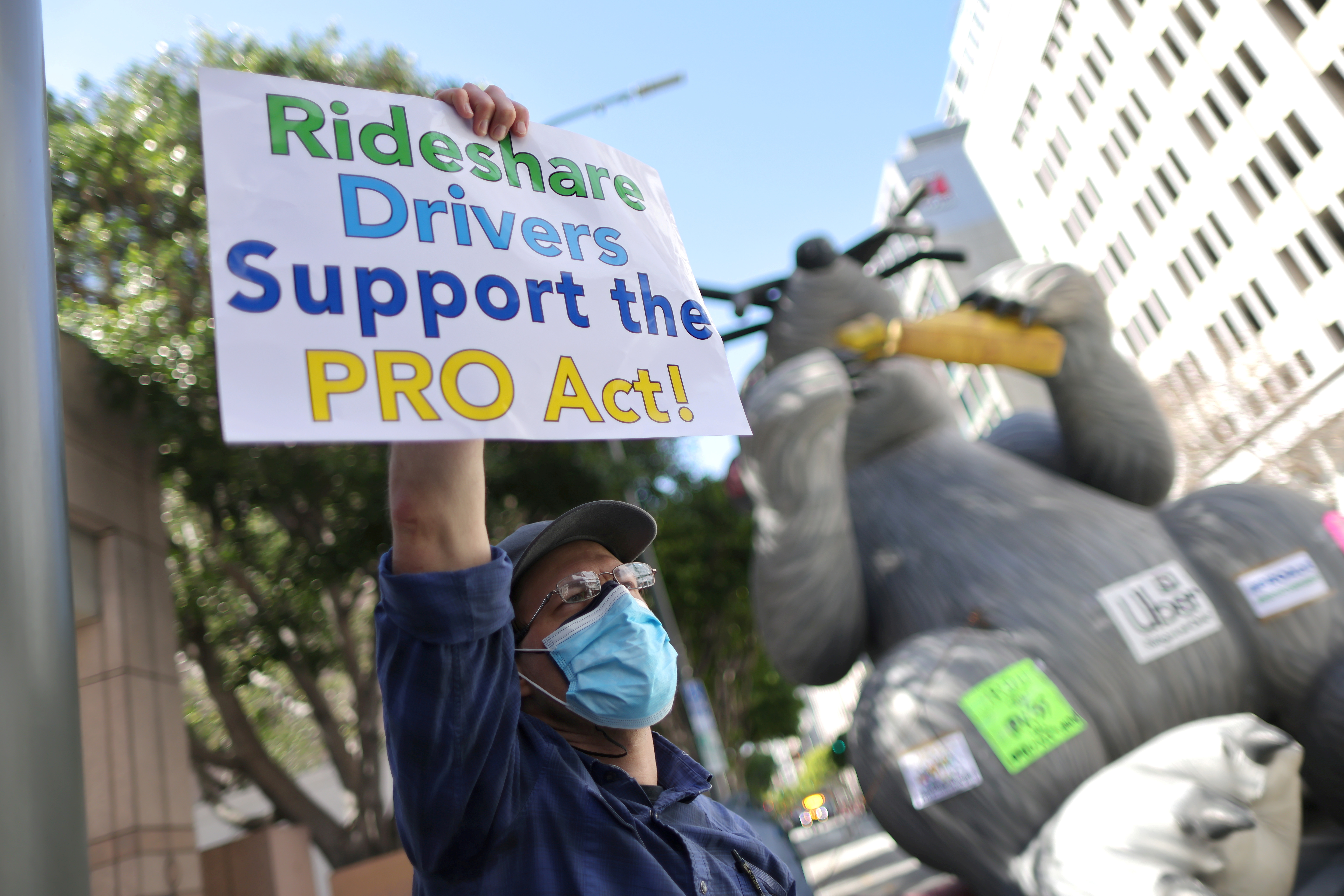 File photo: Rideshare Uber and Lyft drivers rally in support of the Protecting the Right to Organize (PRO) Act, in Los Angeles, California, U.S., March 16, 2021. REUTERS/Lucy Nicholson