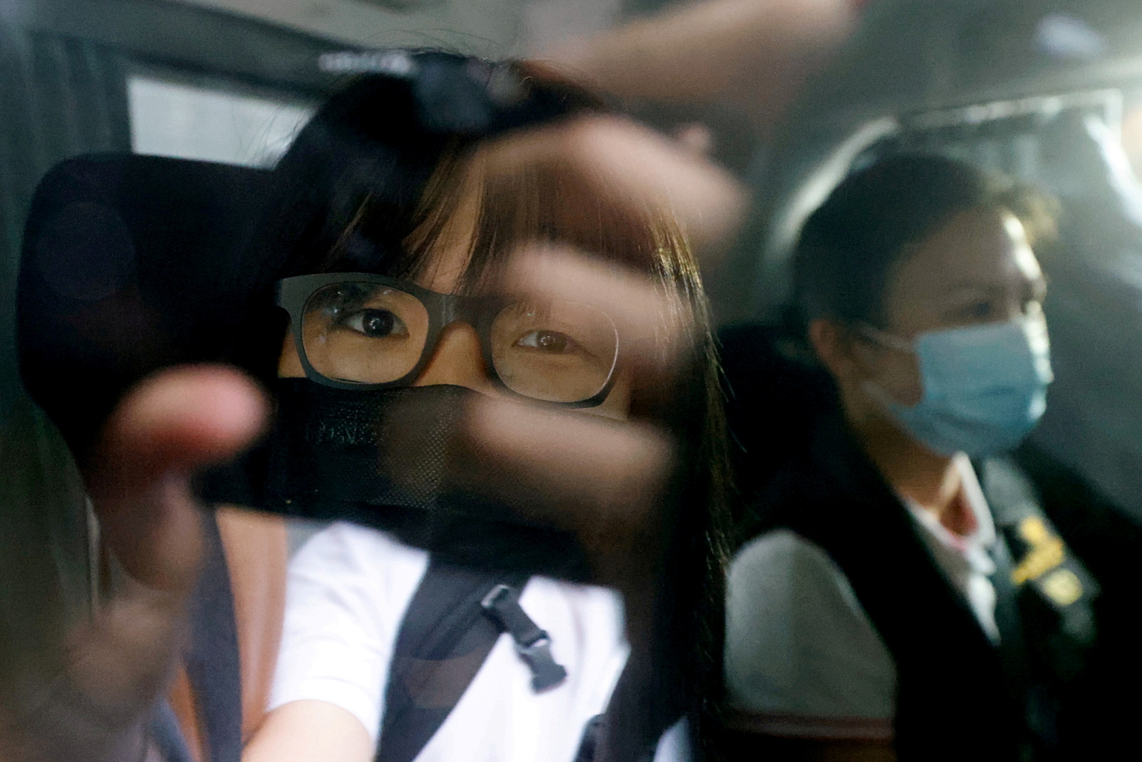 Hong Kong Alliance in Support of Patriotic Democratic Movements of China Vice-Chairwoman Tonyee Chow Hang-tung is seen inside a vehicle after being detained in Hong Kong, China, September 8, 2021. REUTERS/Tyrone Siu/File Photo
