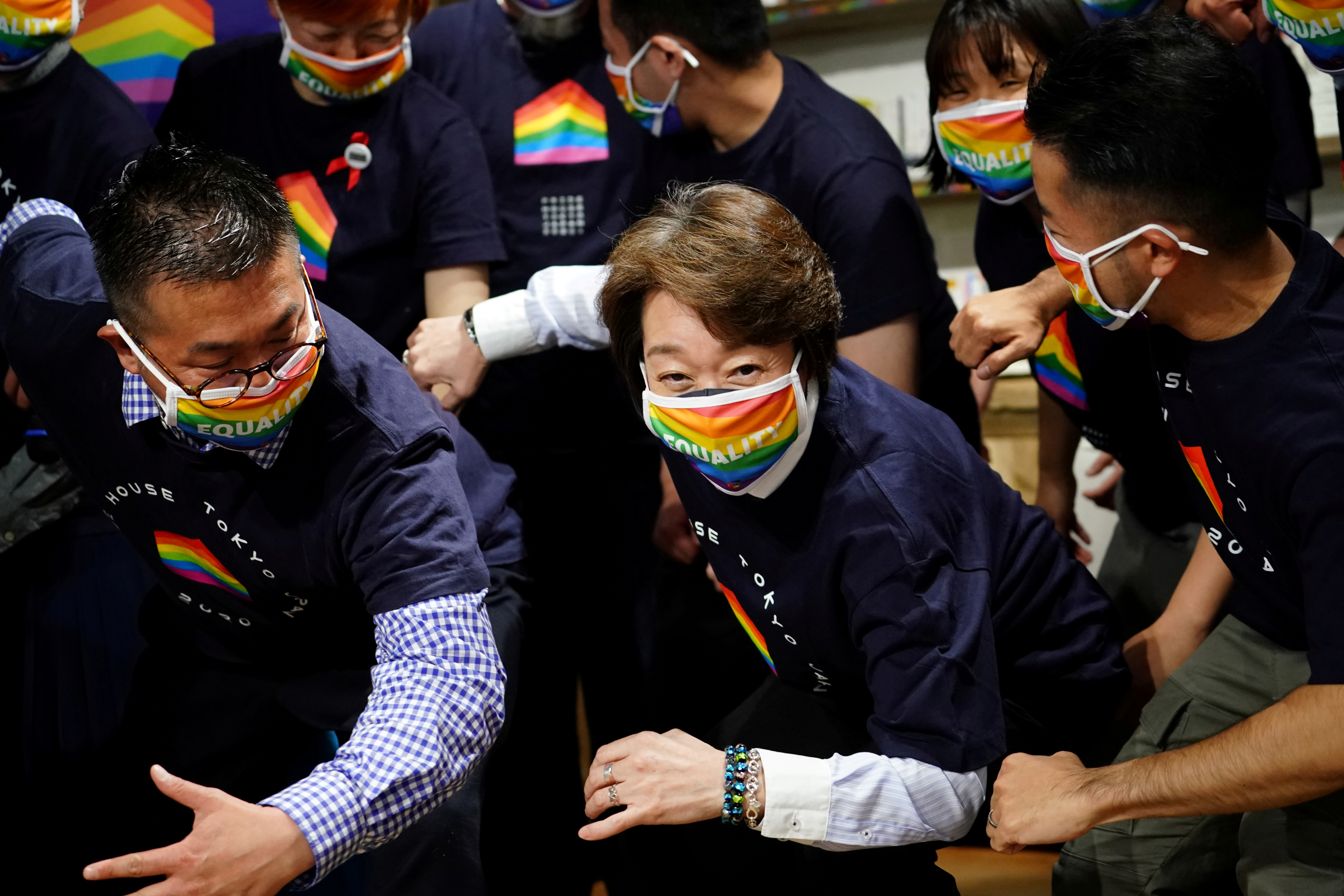 Tokyo 2020 President Seiko Hashimoto poses with representatives, staff and guests during a visit to Pride House Tokyo Legacy, in Tokyo, Japan April 27, 2021. Eugene Hoshiko/Pool via REUTERS/File Photo