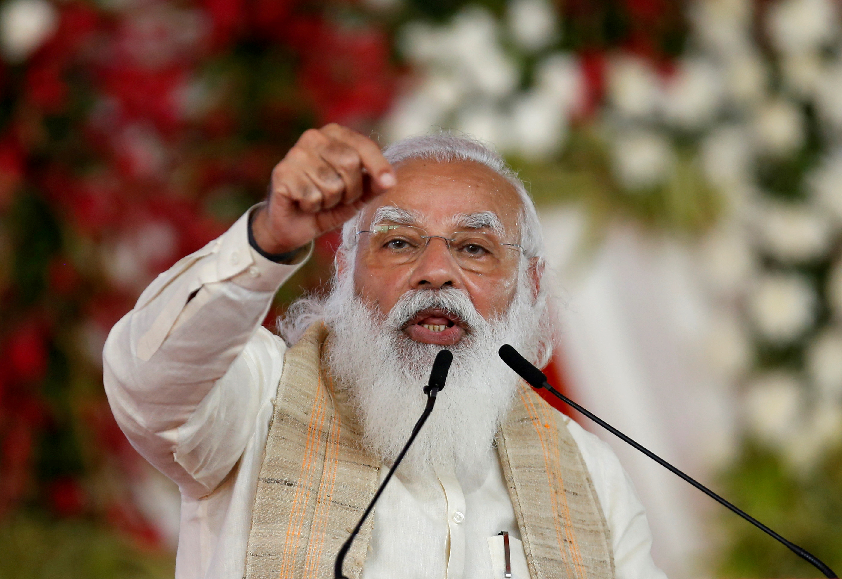India's Prime Minister Narendra Modi addresses a gathering before flagging off the