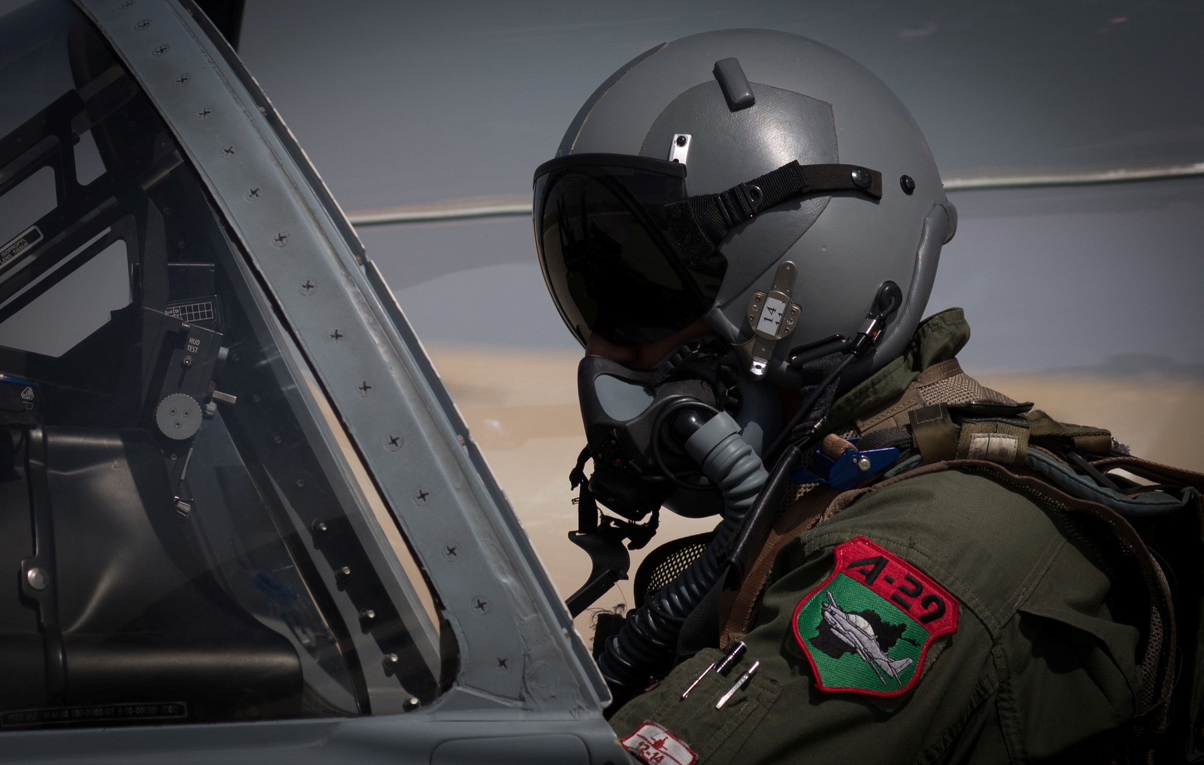 An Afghan A-29 pilot prepared for flight in the cockpit of his aircraft, at Kandahar Airfield, Afghanistan September 10, 2017. Picture taken Septembeer 10, 2017. U.S. Air Force/Staff Sgt. Alexander W. Riedel/Handout via REUTERS