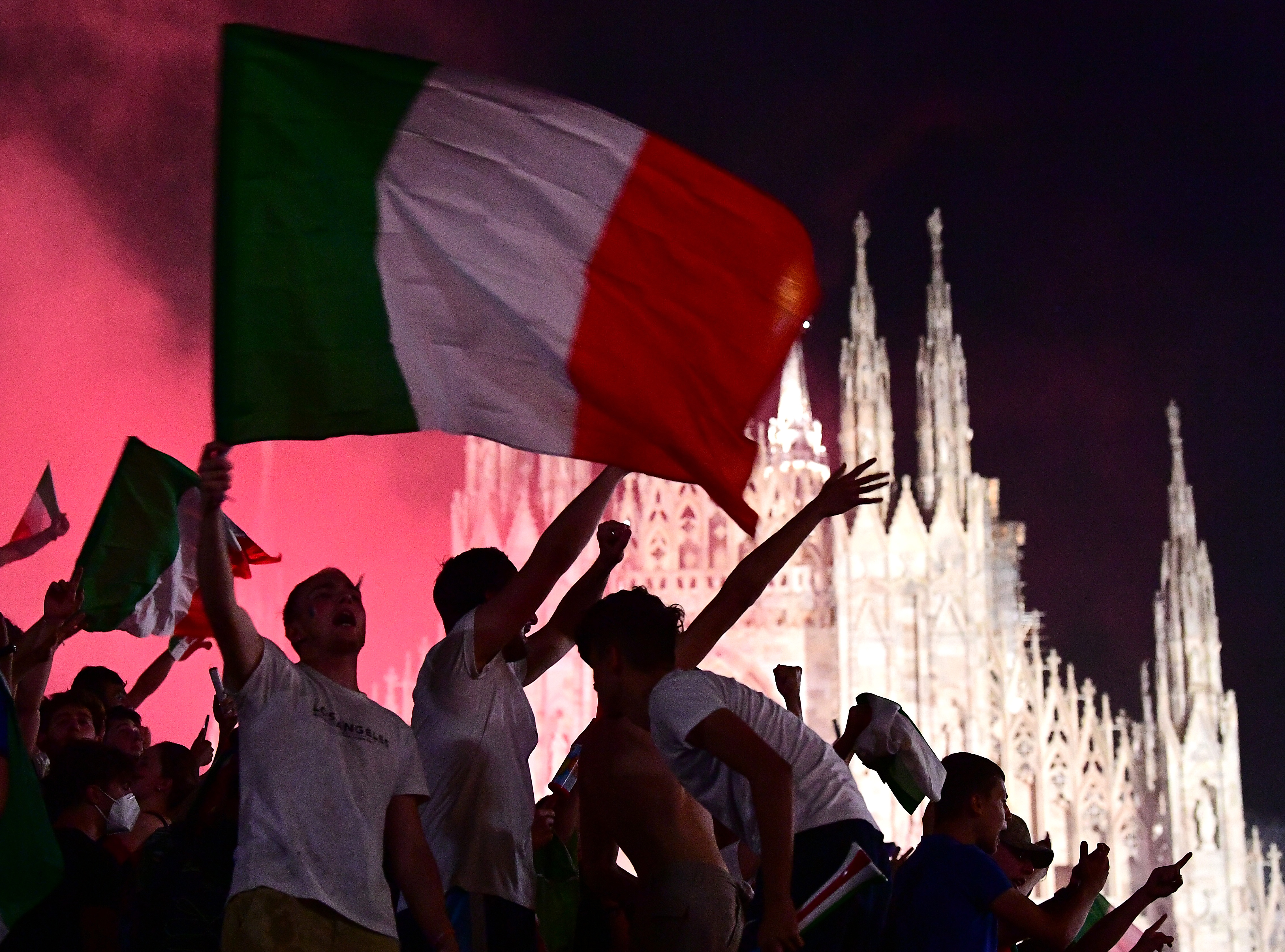 Soccer Football - Euro 2020 - Final - Fans gather for Italy v England - Milan, Italy - July 11, 2021  Italy fans celebrate after winning the Euro 2020 at Piazza Duomo REUTERS/Flavio Lo Scalzo