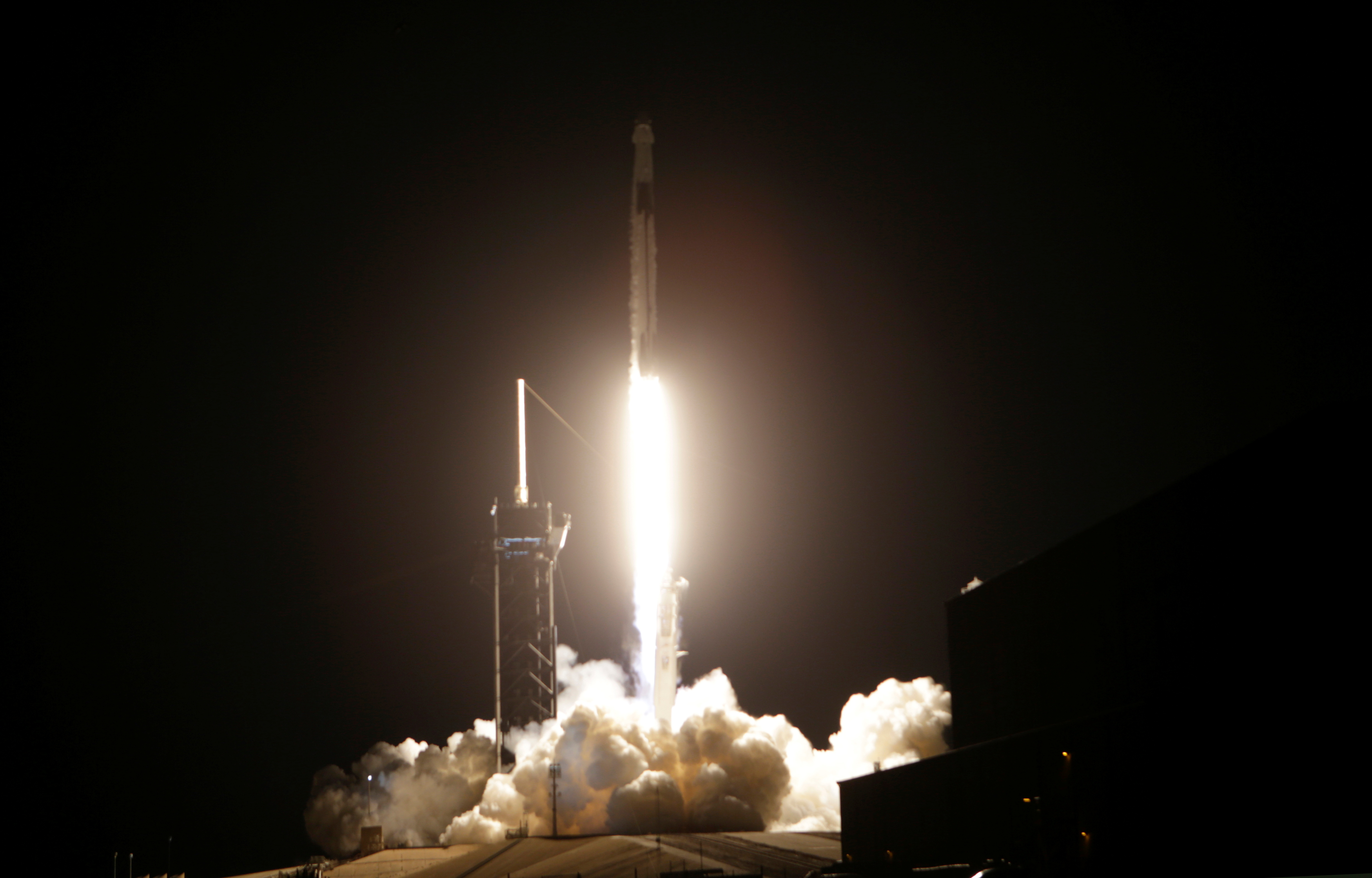 A SpaceX Falcon 9 rocket, topped with the Crew Dragon capsule, is launched carrying four astronauts on the first operational NASA commercial crew mission at Kennedy Space Center in Cape Canaveral, Florida, U.S. November 15, 2020. REUTERS/Joe Skipper