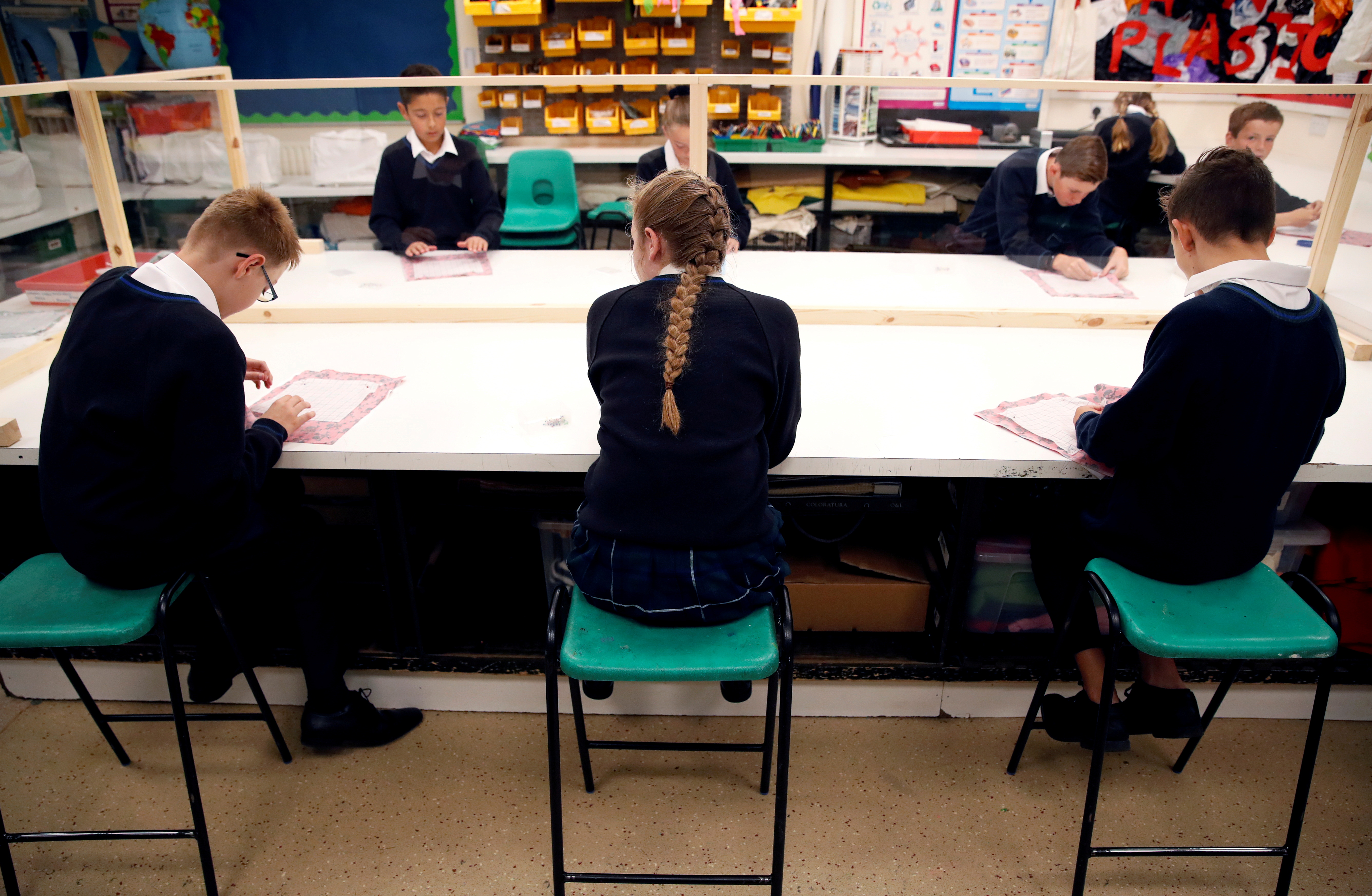 Children sit in a classroom on their first day of school at Heath Mount, amid the outbreak of the coronavirus disease (COVID-19), in Watton at Stone, Britain September 3, 2020. REUTERS/Andrew Couldridge/File Photo