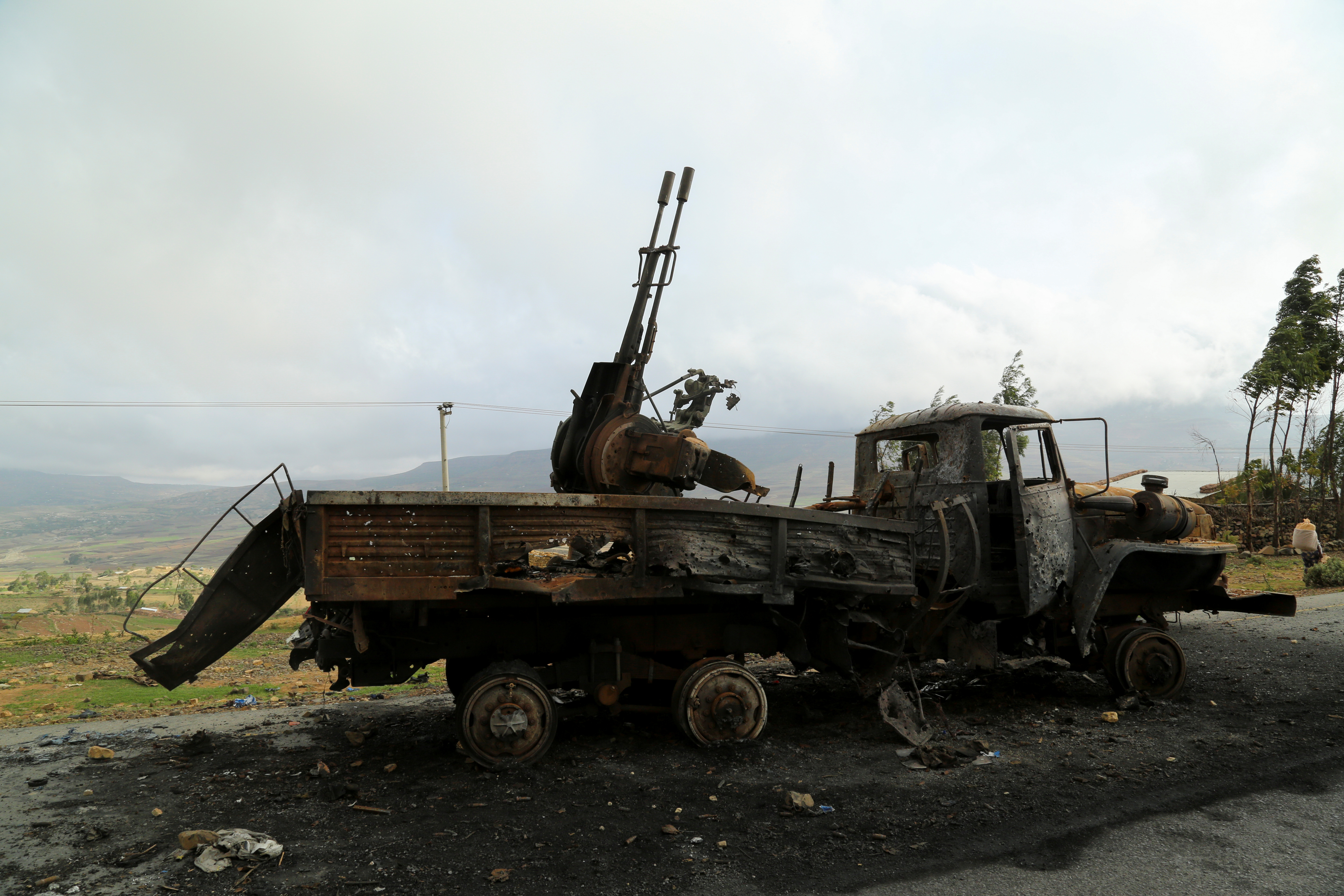 A machine gun mounted in a burnt-out truck on the road to Abiy Addi town in Ethiopia, July 10, 2021. The area saw fierce fighting between Ethiopia's military and Tigrayan forces. REUTERS/Giulia Paravicini