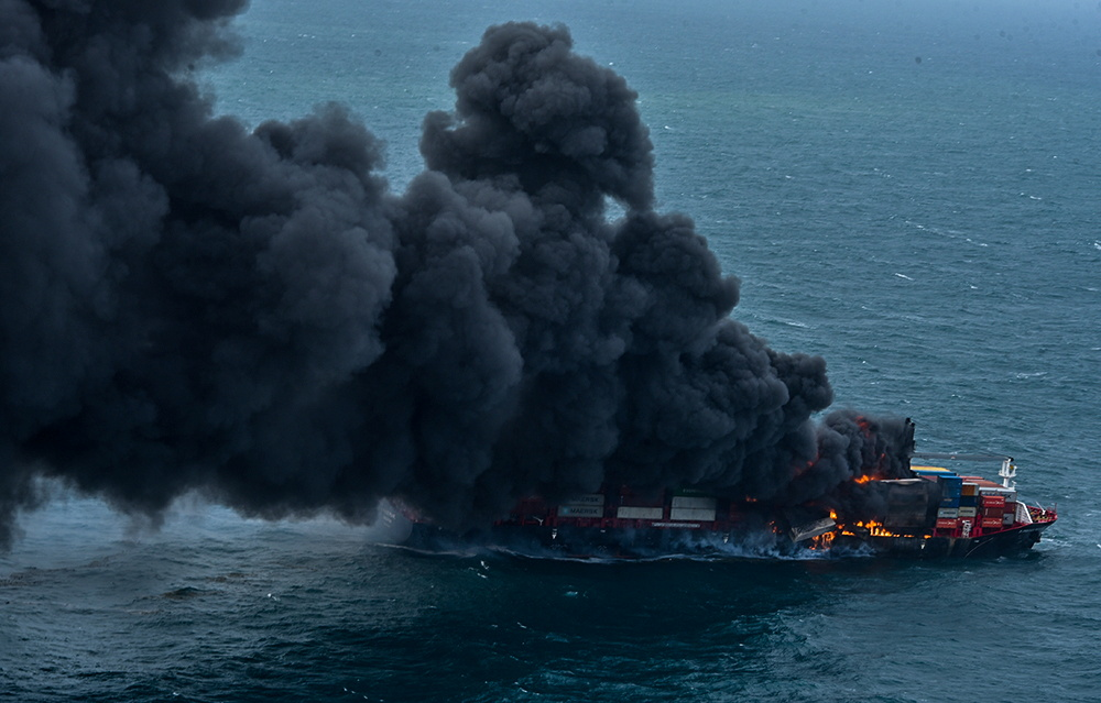 Smoke rises from a fire onboard the MV X-Press Pearl container ship off the Colombo Harbour, in Sri Lanka May 25, 2021. Sri Lanka Airforce Media/Handout via REUTERS