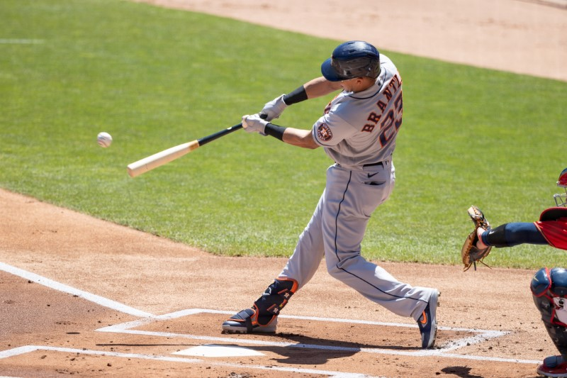 Jun 13, 2021; Minneapolis, Minnesota, USA; Houston Astros designated hitter Michael Brantley (23) hits a double during the first inning against the Minnesota Twins at Target Field. Mandatory Credit: Jordan Johnson-USA TODAY Sports