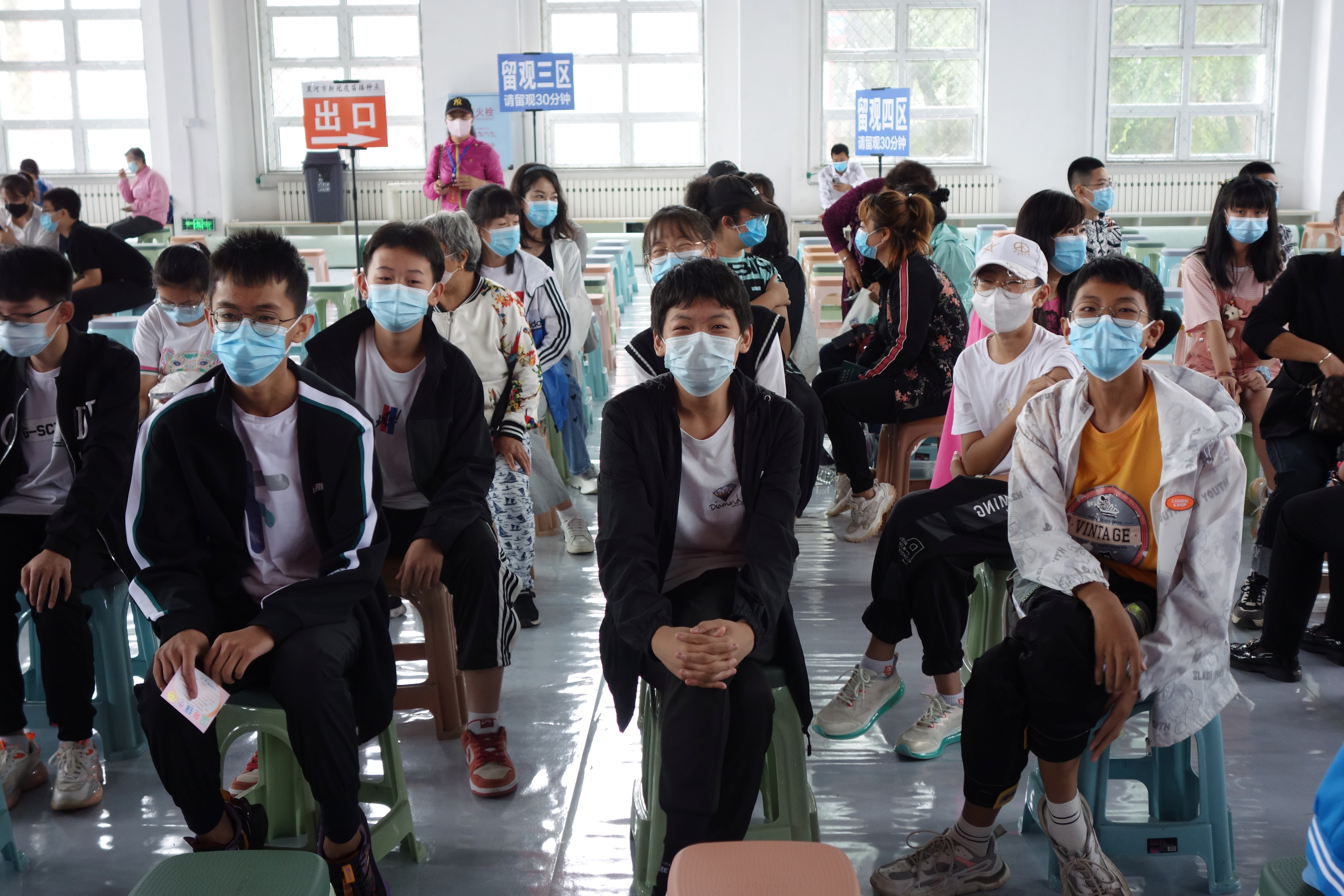 Residents wait at the observation area during a coronavirus disease (COVID-19) vaccination session for those aged between 12 and 14, in Heihe, Heilongjiang province, China August 3, 2021. China Daily via REUTERS