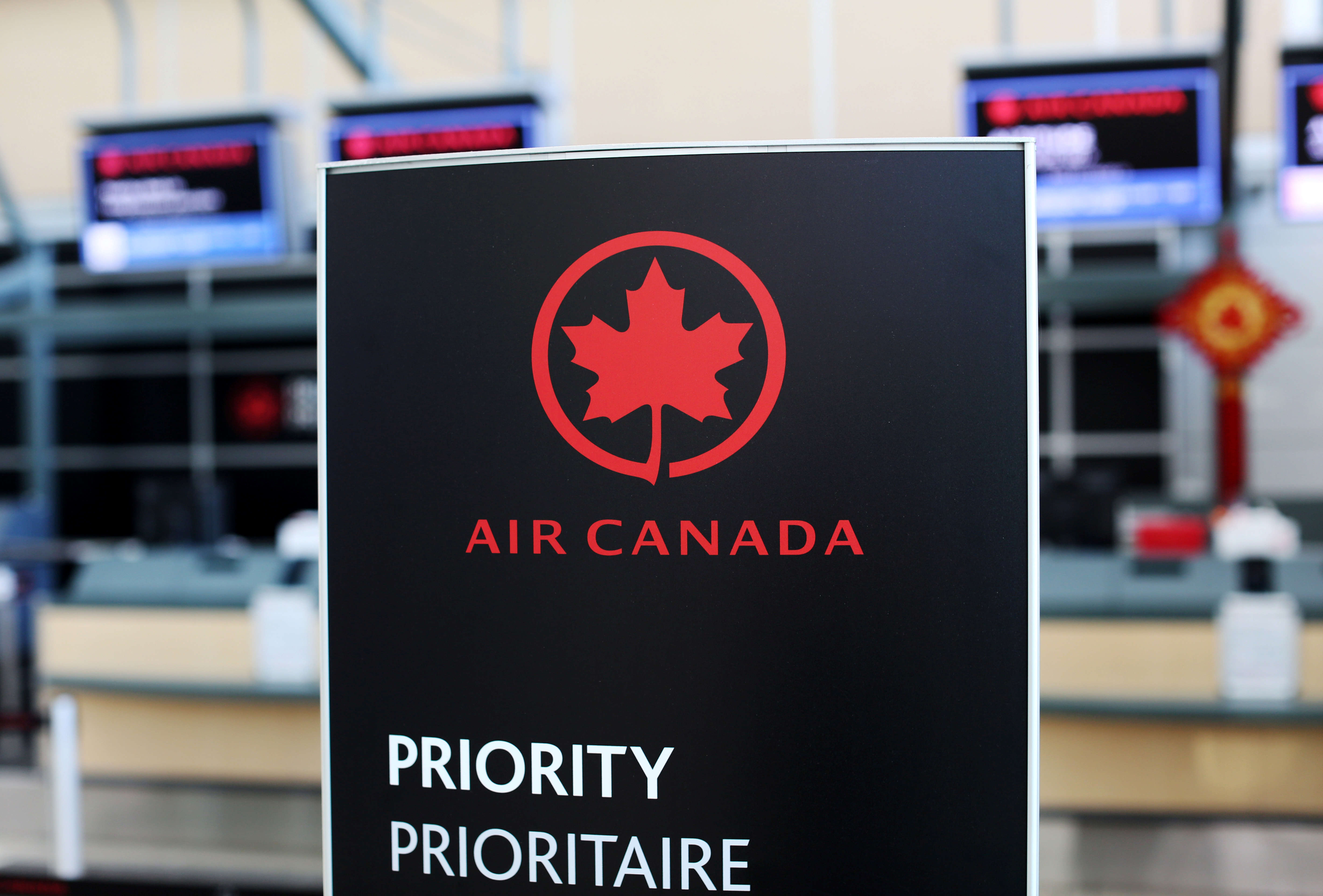 Air Canada signage is pictured at Vancouver's international airport in Richmond, British Columbia, Canada, February 5, 2019.  REUTERS/Ben Nelms