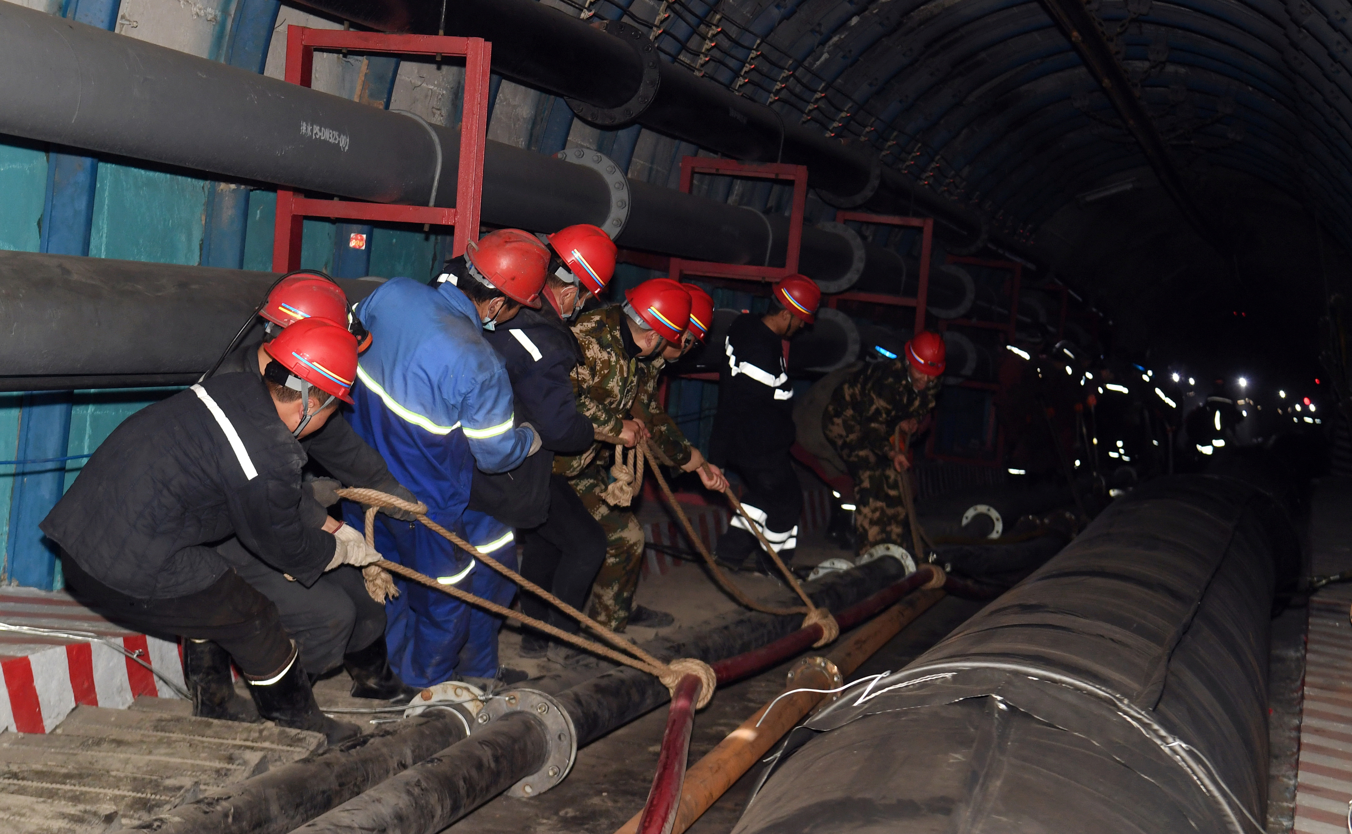 Rescuers work at the site where a coal mine flooded in Hutubi county, Xinjiang Uighur Autonomous Region, China April 11, 2021. China Daily via REUTERS