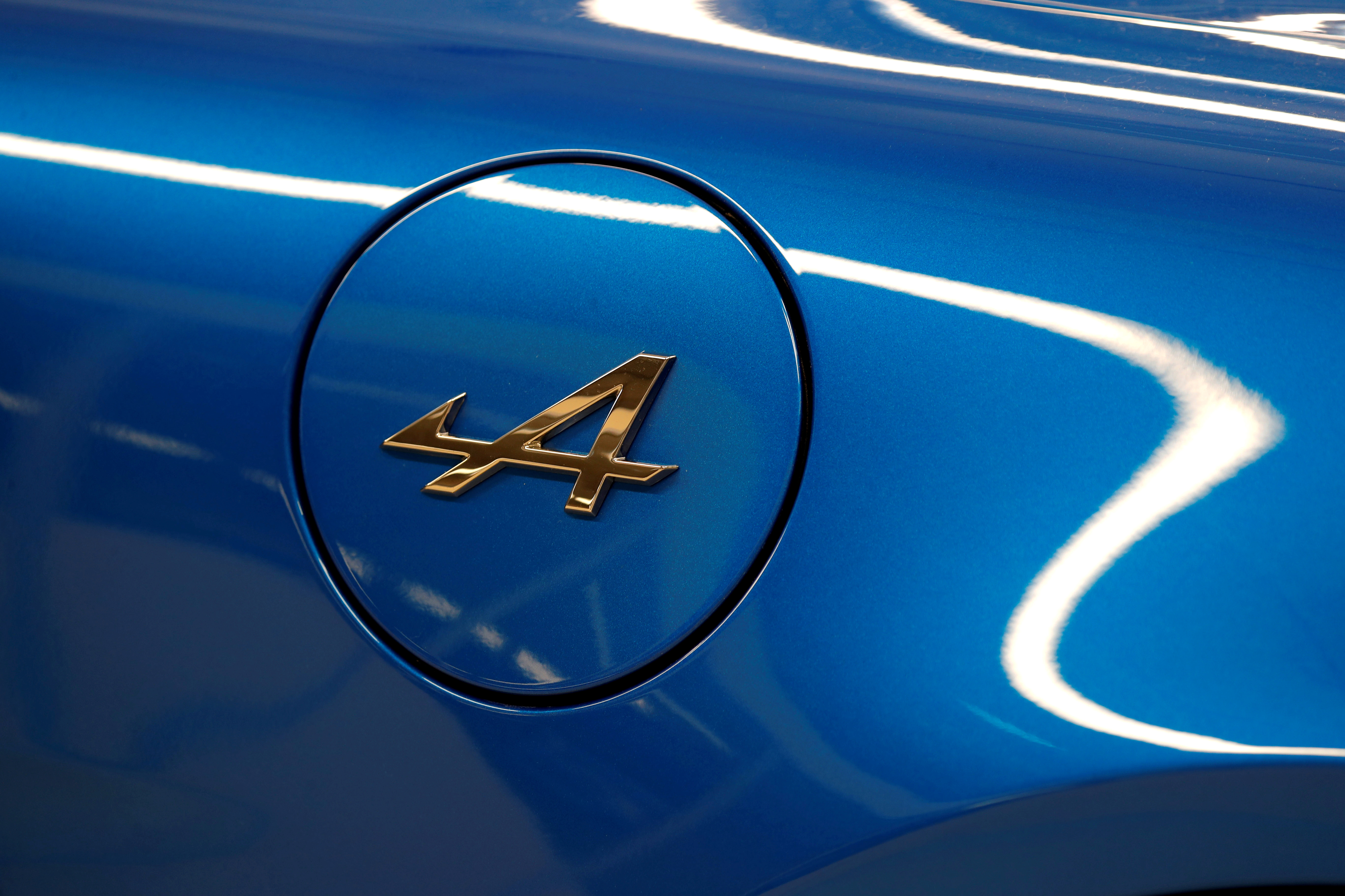 The Alpine logo is seen on the new Alpine A110 sports car during the inauguration of the new production line in Dieppe, France, December 14, 2017. REUTERS/Charles Platiau/File Photo