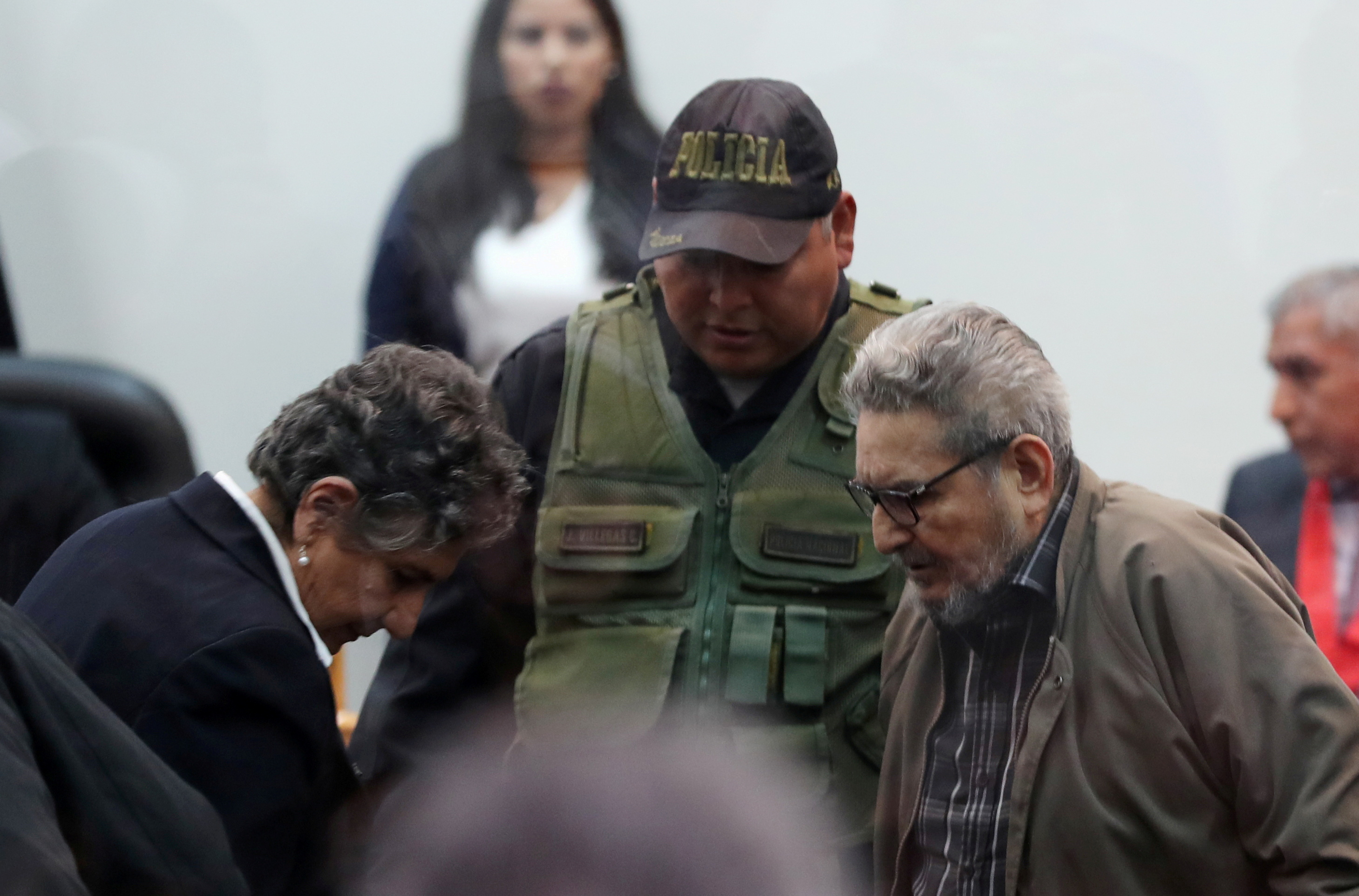 Shining Path founder Abimael Guzman and his wife and second leader Elena Iparraguirre attend a trial during sentence of a 1992 Shining Path car bomb case in Miraflores, at a high security naval prison in Callao, Peru September 11, 2018. Picture taken through a window. REUTERS/Mariana Bazo/File Photo