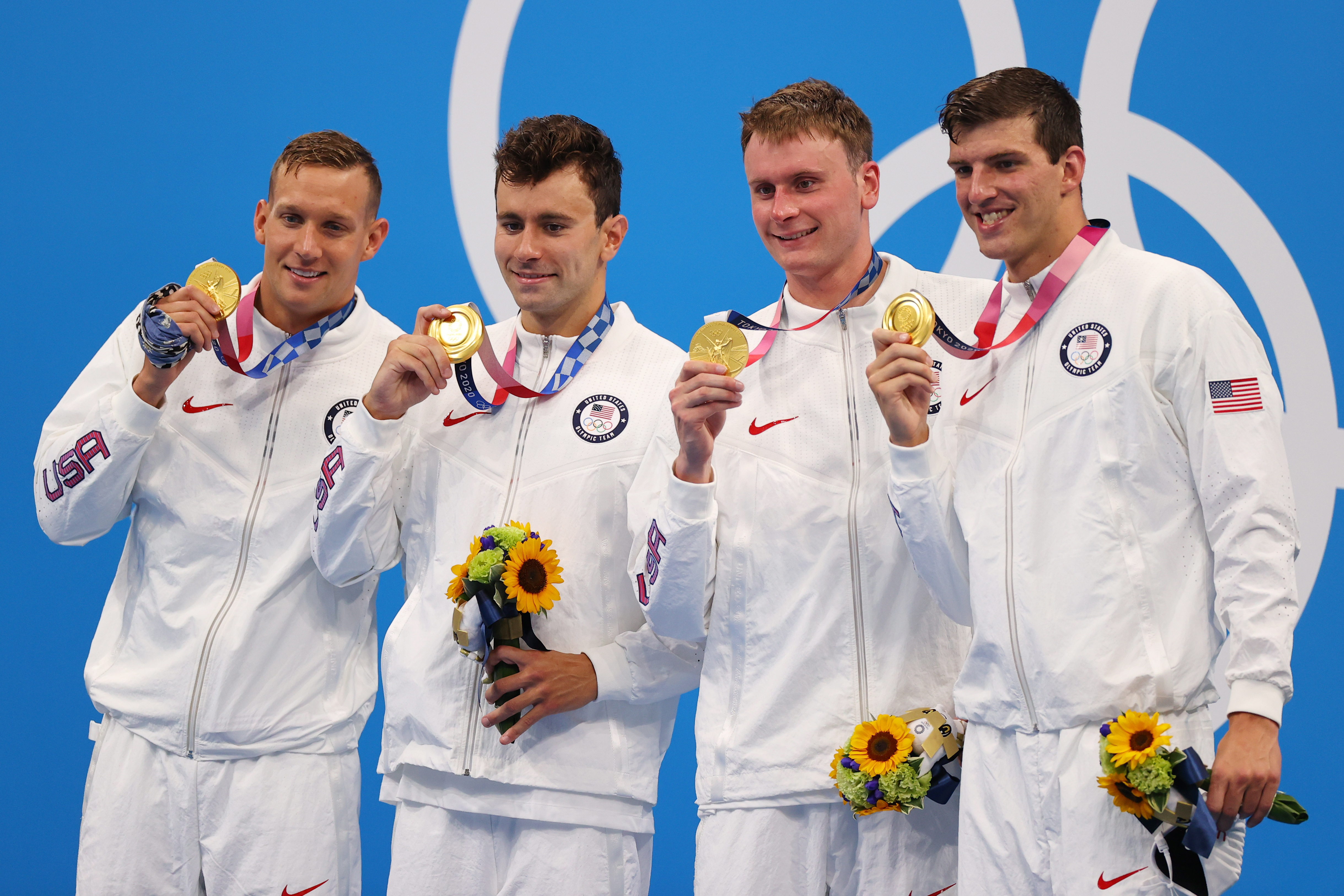 Tokyo 2020 Olympics - Swimming - Men's 4 x 100m Freestyle Relay - Medal Ceremony - Tokyo Aquatics Centre - Tokyo, Japan - July 26, 2021.  Caeleb Dressel of the United States, Blake Pieroni of the United States, Bowen Becker of the United States and Zach Apple of the United States pose with their gold medals. REUTERS/Marko Djurica
