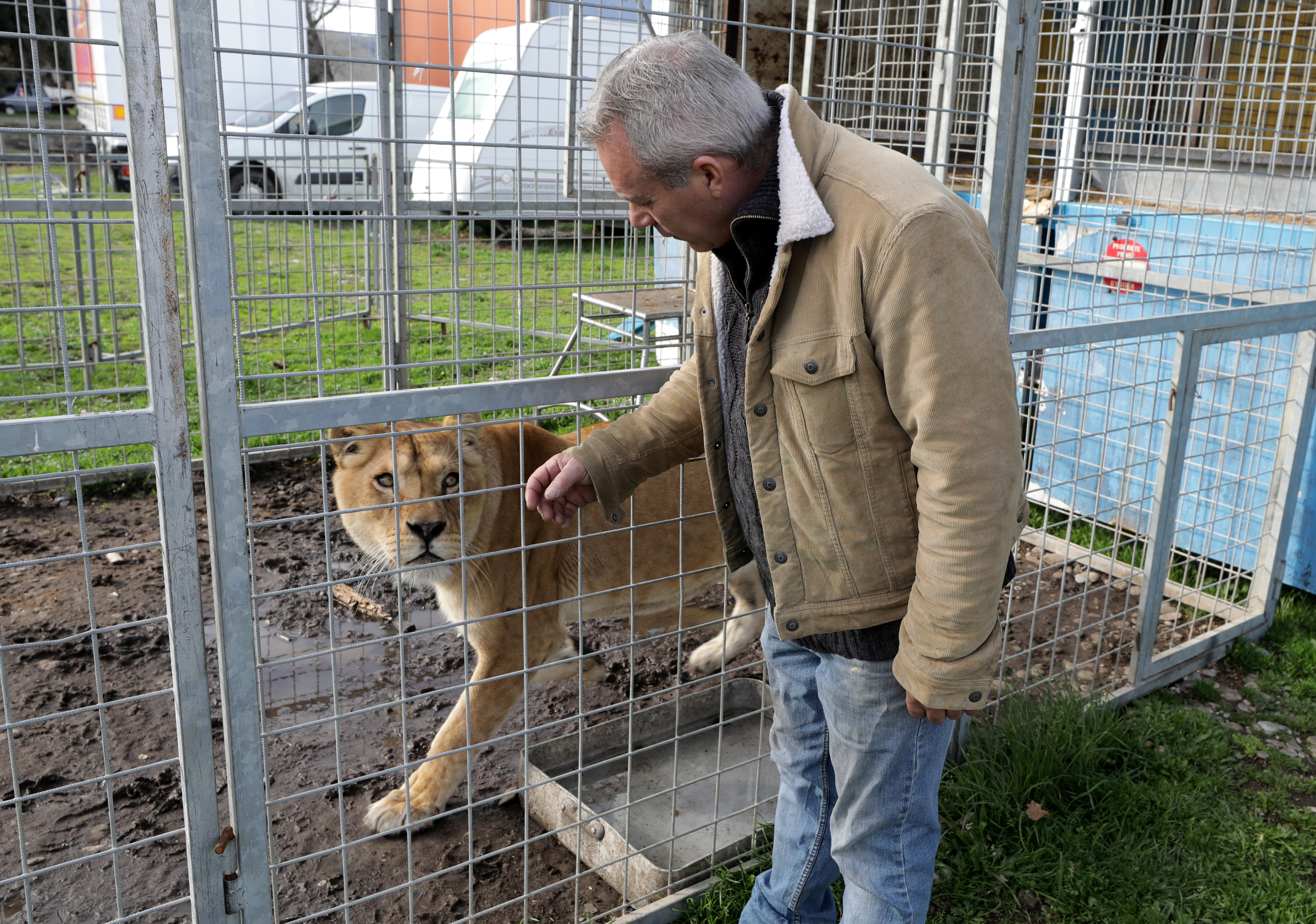 William Kerwich, owner of the Royal Circus and President of the Circus and Shows Animals Union, poses with a lion at the circus home base in Senas as circus shows remained shut as part of COVID-19 restrictions measures to fight the coronavirus disease outbreak in France, February 9, 2021. Kerwich also denounced an animal welfare bill which is debated by French lawmakers that would ban using wild animals in traveling circuses and keeping dolphins and whales in captivity in marine parks. Picture taken February 9, 2021. REUTERS/Eric Gaillard