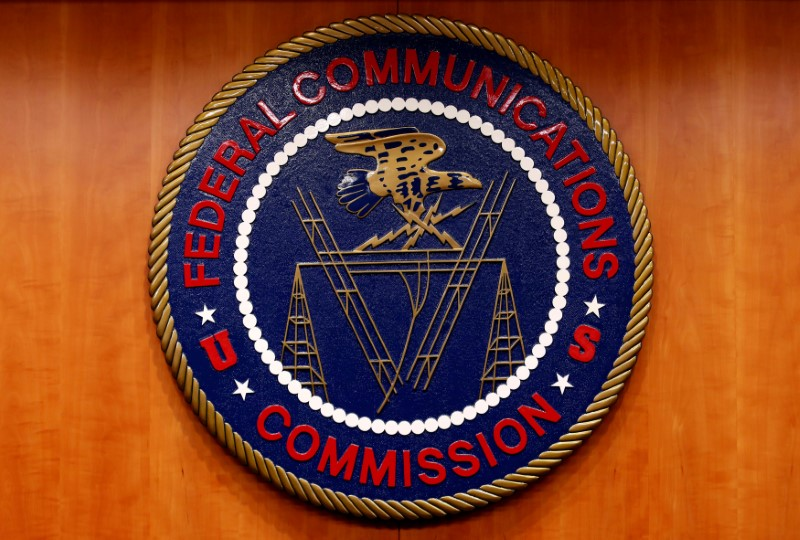 The Federal Communications Commission (FCC) logo is seen before the FCC Net Neutrality hearing in Washington February 26, 2015. REUTERS/Yuri Gripas/File Photo