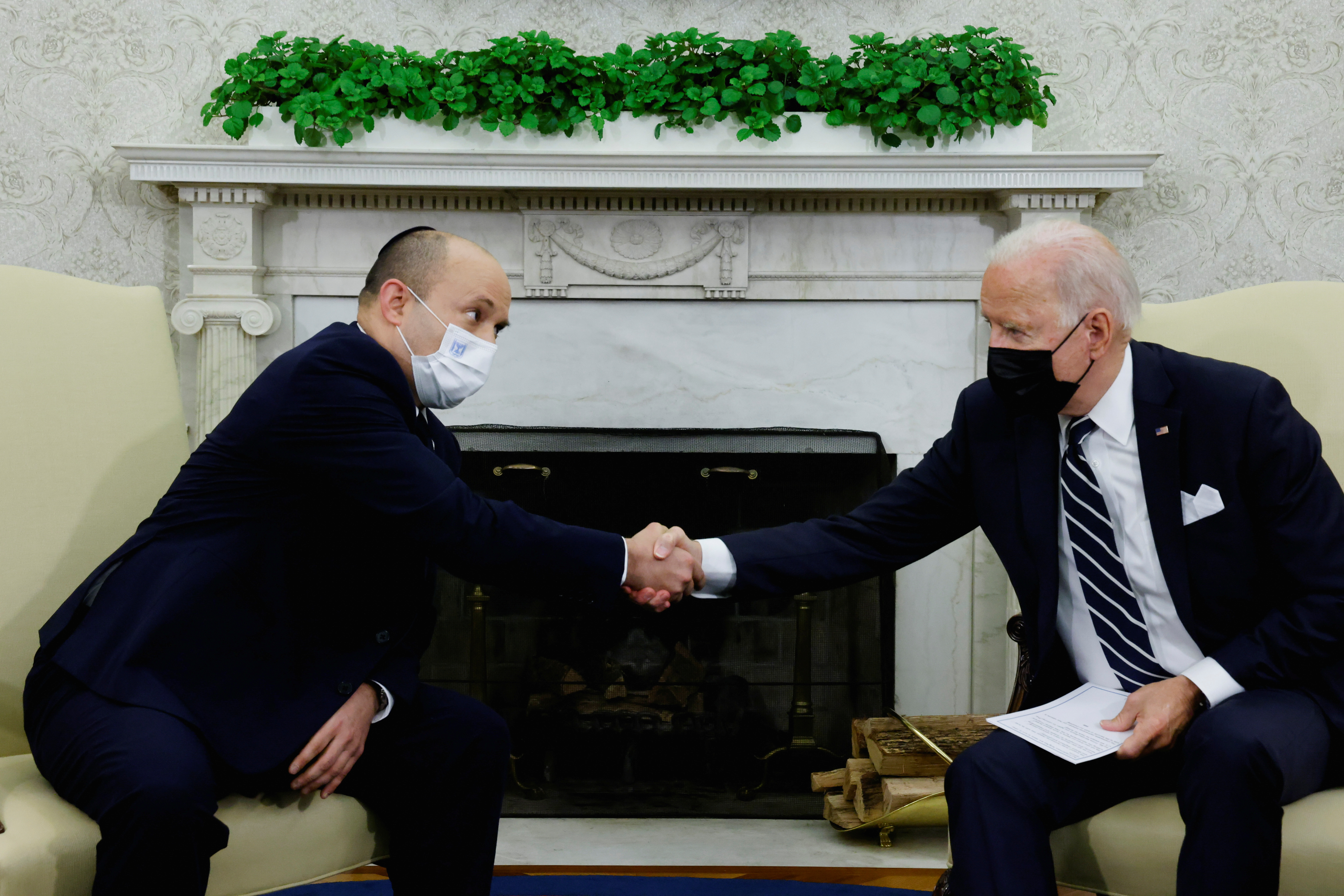 U.S. President Joe Biden and Israel's Prime Minister Naftali Bennett shake hands during a meeting in the Oval Office at the White House in Washington, U.S. August 27, 2021. REUTERS/Jonathan Ernst