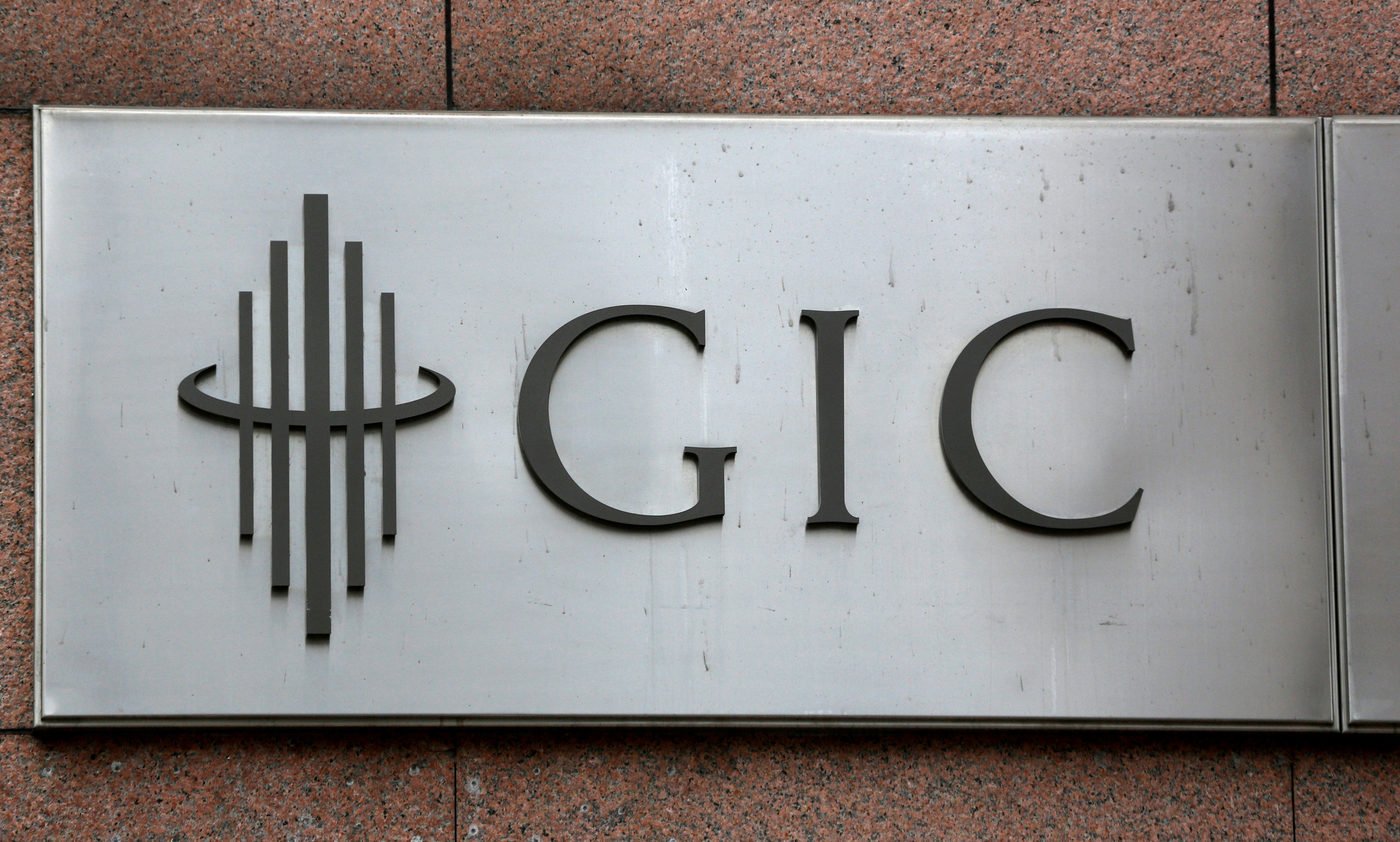 The logo for Singapore sovereign wealth fund GIC Pte Ltd, is seen on a building in Singapore July 6, 2017. REUTERS/Darren Whiteside/File Photo