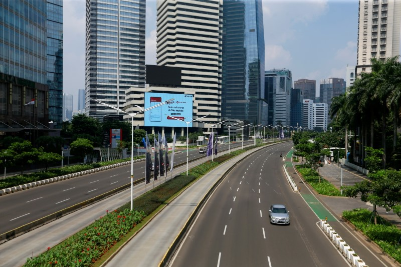 A general view shows a deserted main road during the imposition of large-scale social restrictions by the government to prevent the spread of the coronavirus disease (COVID-19) in Jakarta, Indonesia, July 3, 2021. REUTERS/Ajeng Dinar Ulfiana