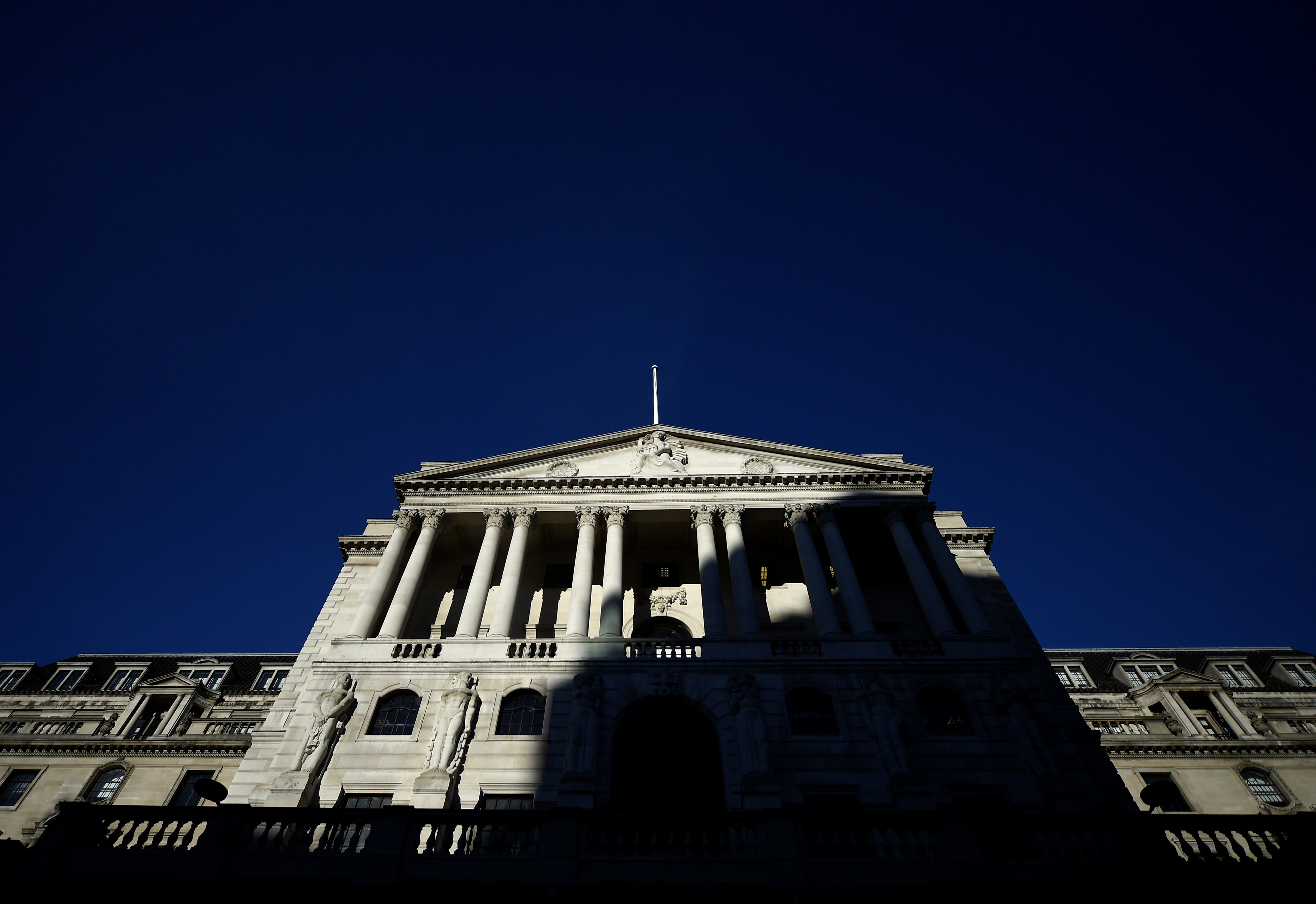An adjacent building throws a shadow accross the Bank of England in the City of London, Britain, December 12, 2017. REUTERS/Clodagh Kilcoyne
