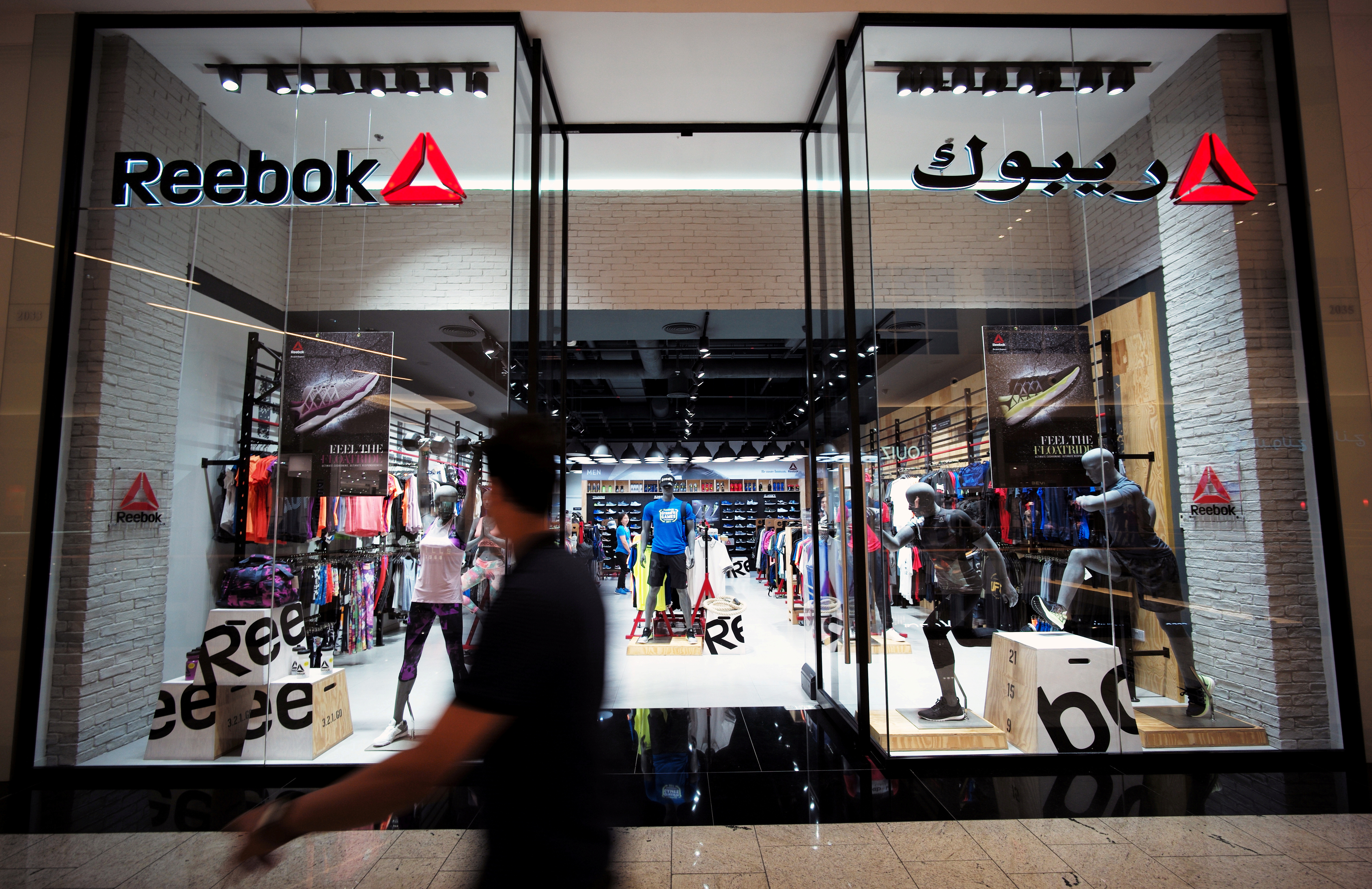 A man walks in front of the Reebok store at Bahrain City Center in Manama, Bahrain September 17, 2017. REUTERS/Hamad I Mohammed/File Photo