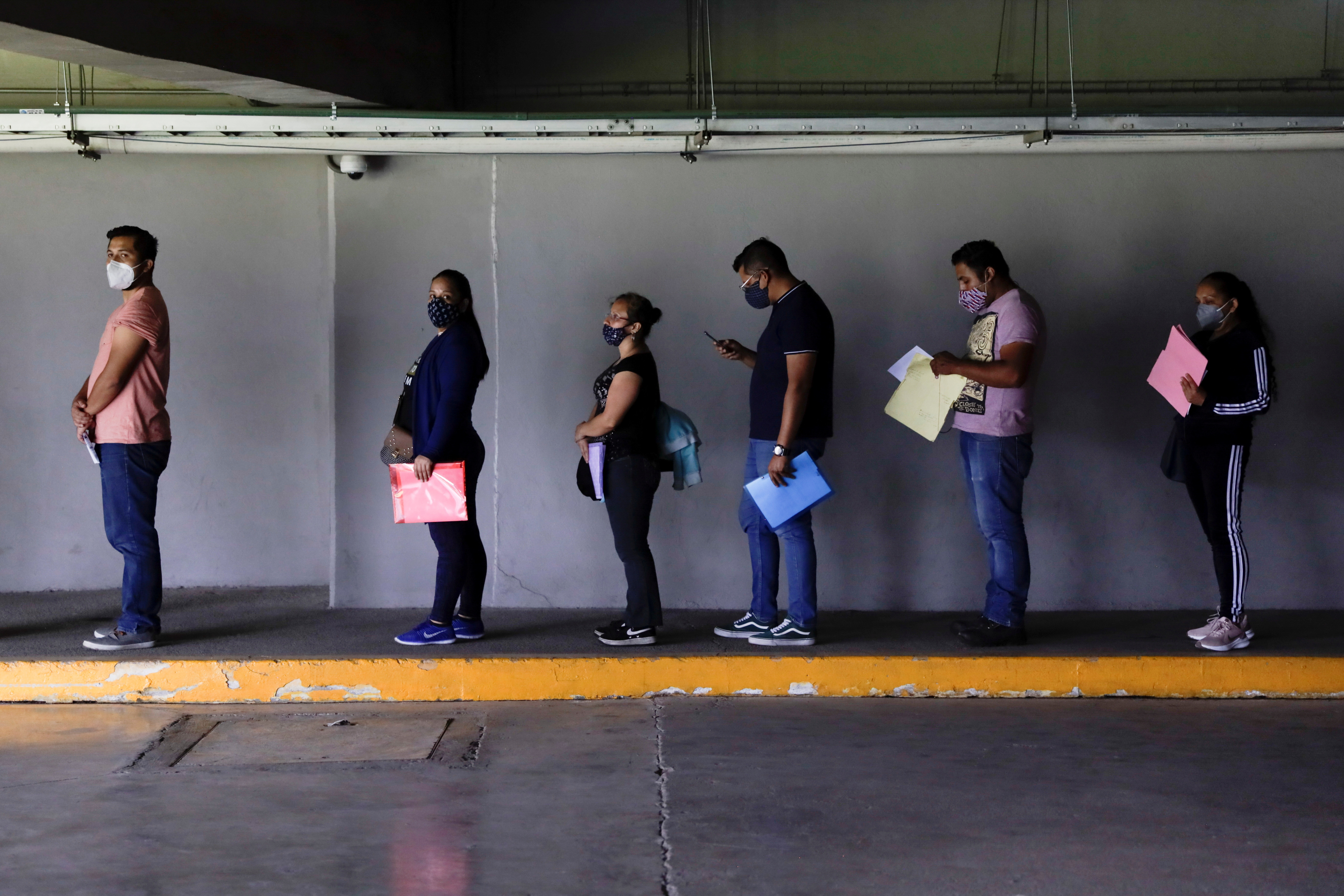 People queue to receive a dose of the Sputnik V coronavirus disease (COVID-19) vaccine at the Mexico City Arena, in Mexico City, Mexico July 20, 2021. REUTERS/Luis Cortes/File Photo
