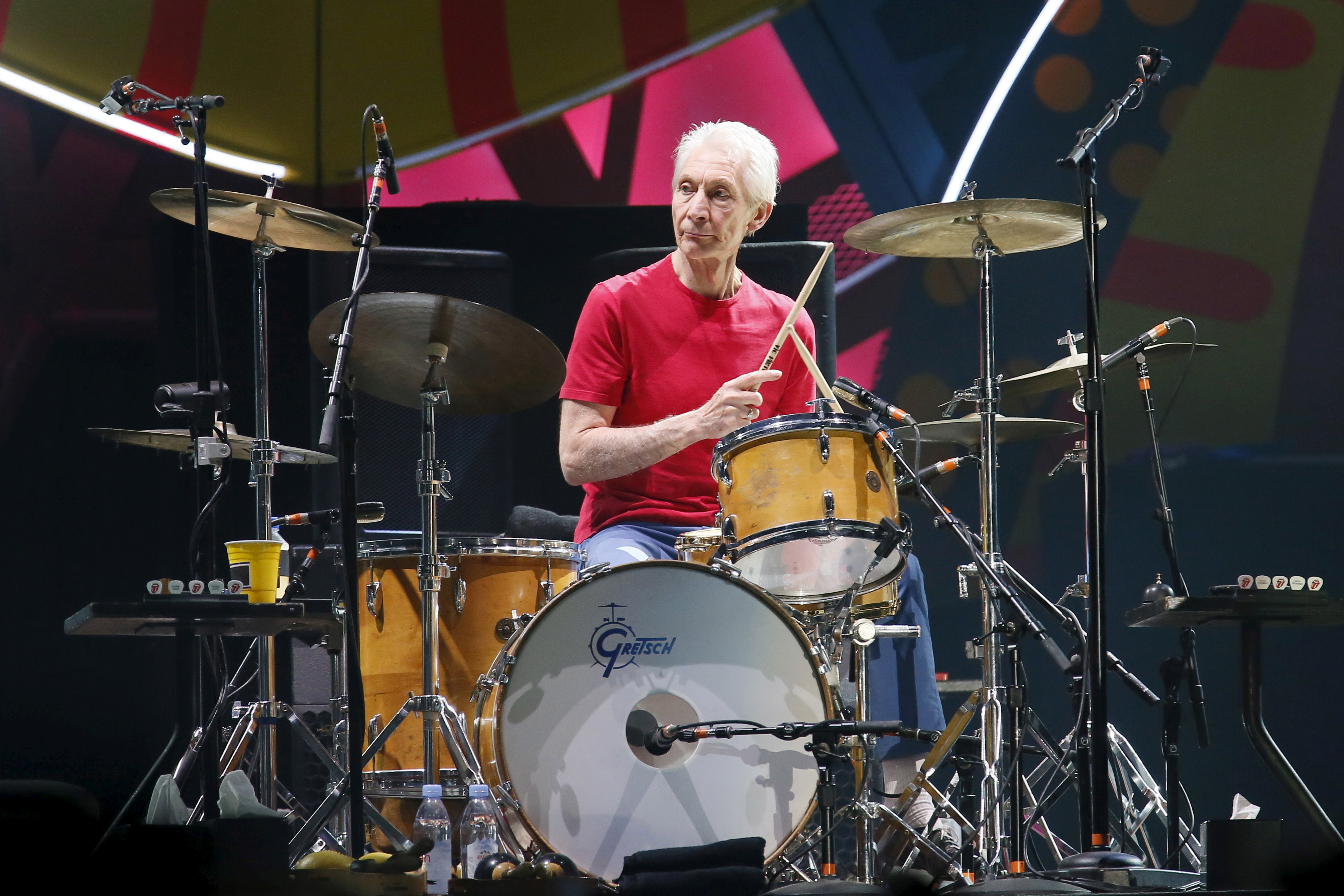 Charlie Watts of British veteran rockers The Rolling Stones performs with his band members Mick Jagger, Keith Richards, and Ronnie Wood during a concert on their