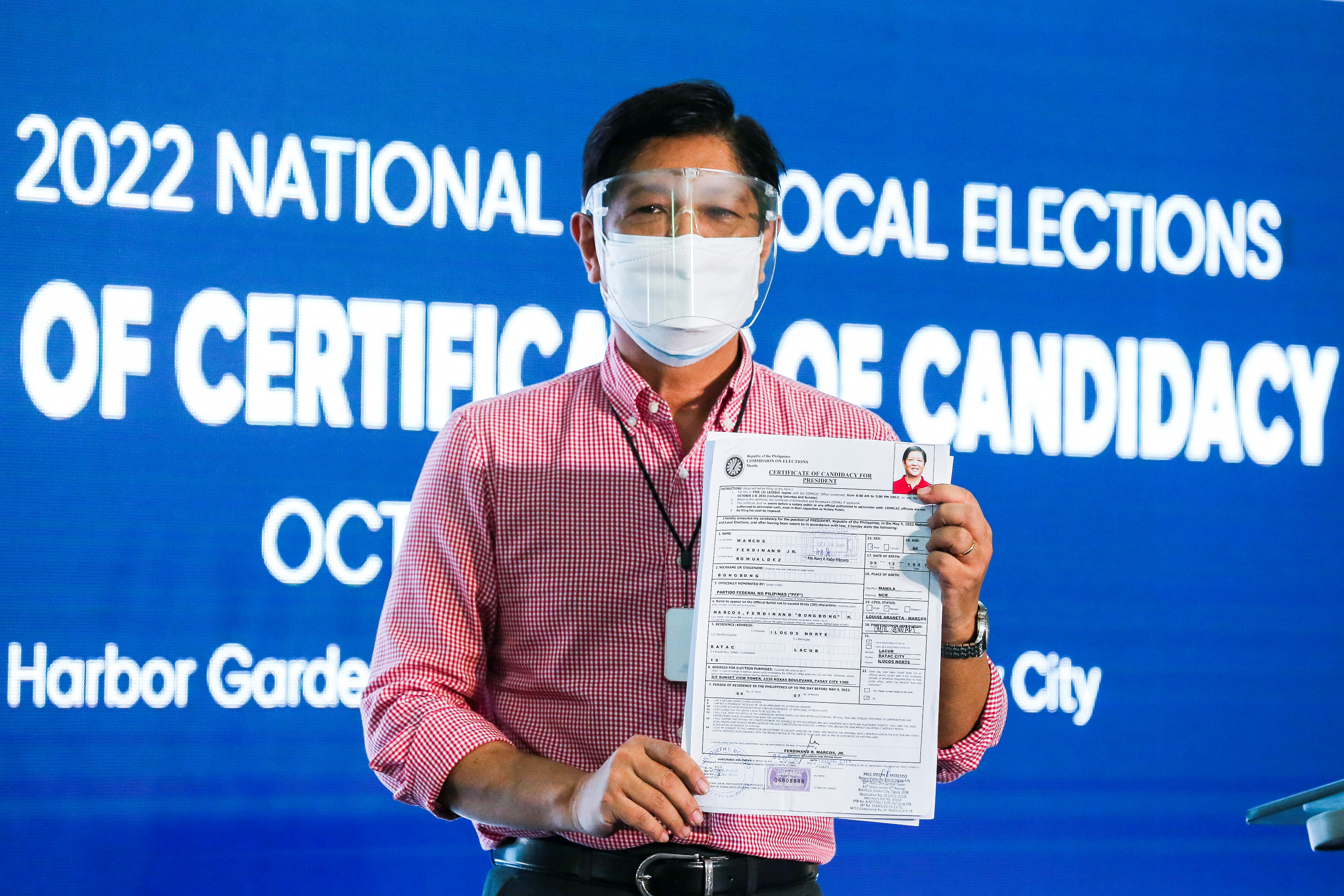 Ferdinand Marcos Jr, the son of late Philippines dictator Ferdinand Marcos, poses for pictures after filing his certificate of candidacy for president in the 2022 national election, in Pasay City, Metro Manila, Philippines, October 6, 2021. Rouelle Umali/Pool via Reuters