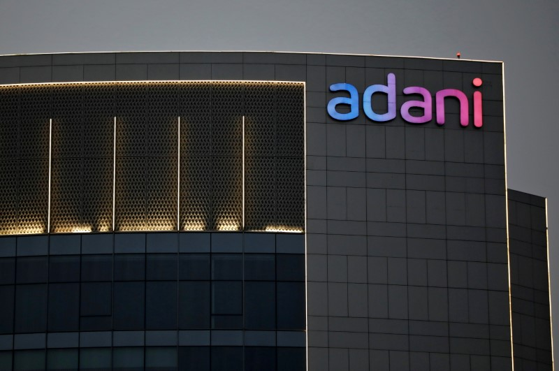 The logo of the Adani Group is seen on the facade of one of its buildings on the outskirts of Ahmedabad, India, April 13, 2021. REUTERS/Amit Dave