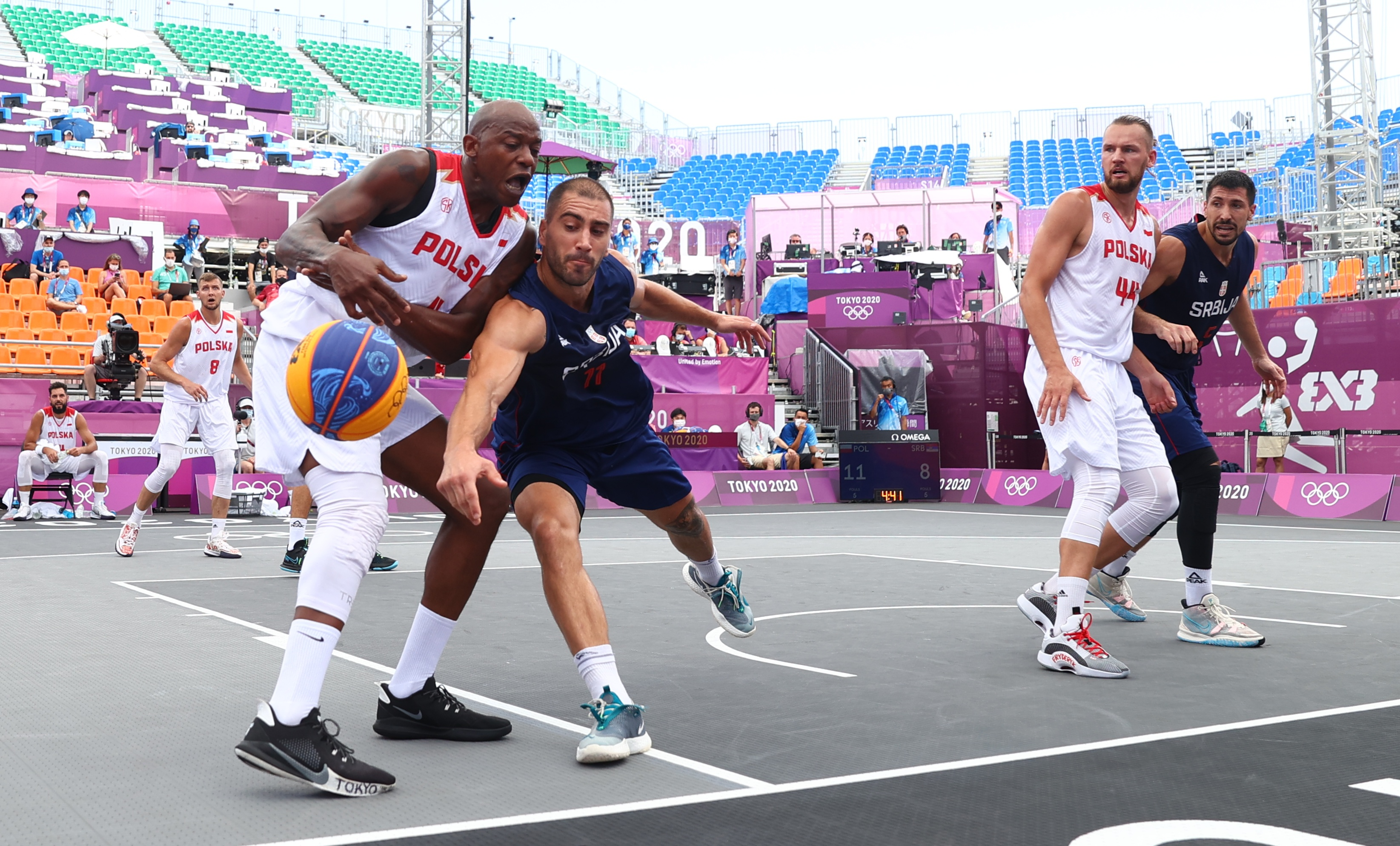 Tokyo 2020 Olympics - Basketball 3x3 - Men - Pool A - Poland v Serbia - Aomi Urban Sports Park, Tokyo, Japan - July 25, 2021.Michael Hicks of Poland  in action with Mihailo Vasic of Serbia  during the match. REUTERS/Andrew Boyers