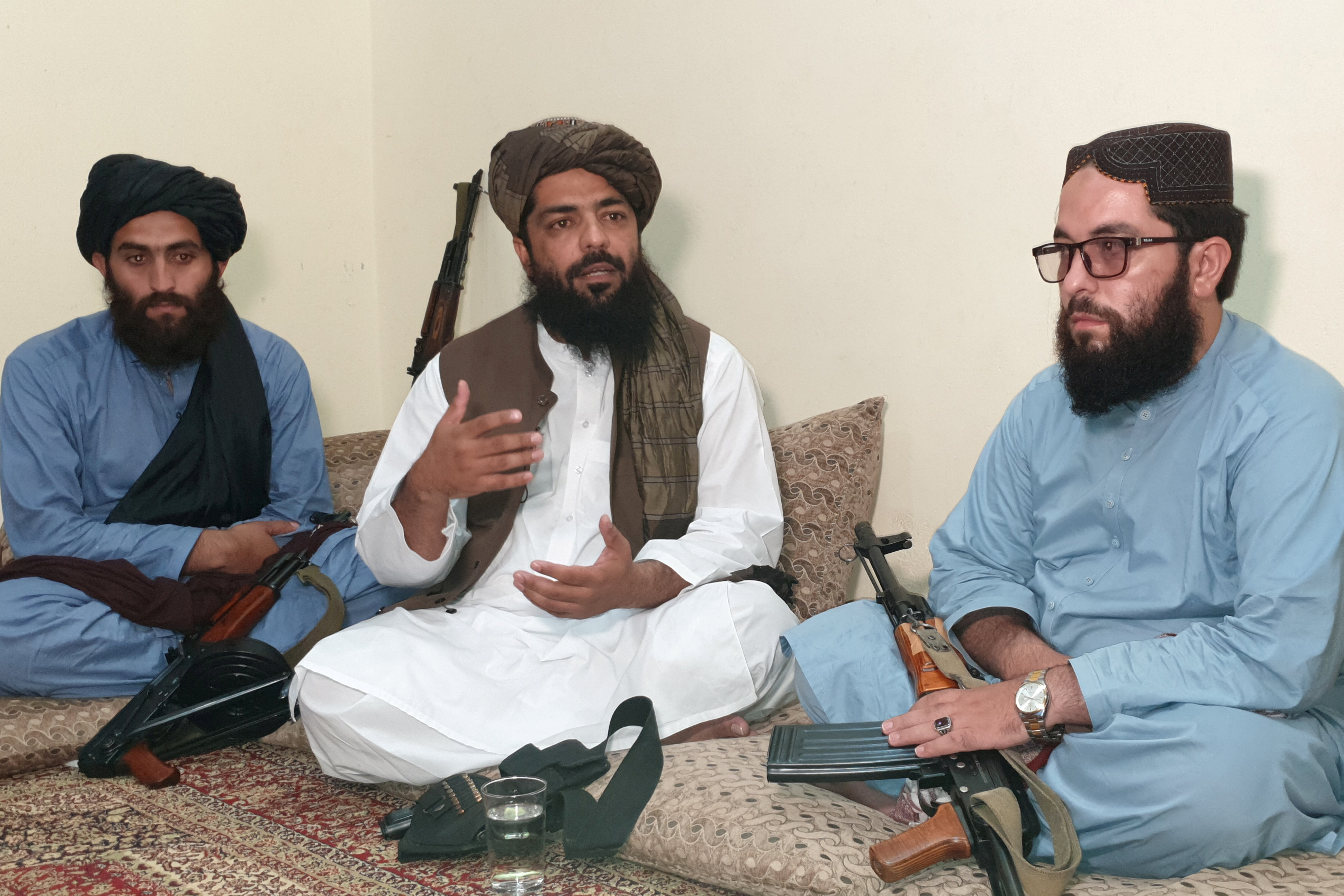 Waheedullah Hashimi (C), a senior Taliban commander, gestures as he speaks with Reuters during an interview at an undisclosed location near Afghanistan-Pakistan border August 17, 2021. Picture taken August 17, 2021. REUTERS/Stringer