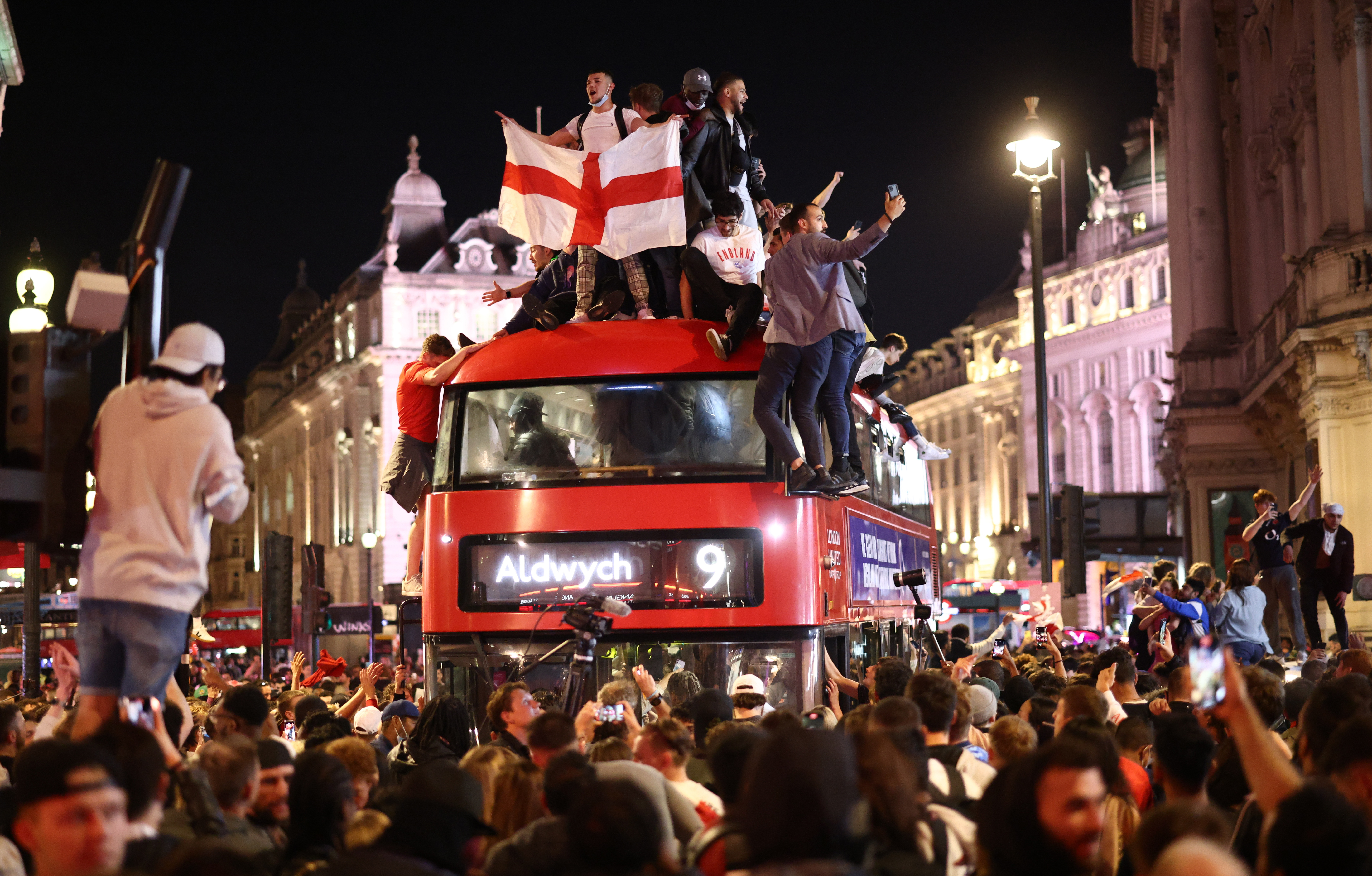 Soccer Football - Euro 2020 - Fans gather for England v Denmark - Piccadilly Circus, London, Britain - July 7, 2021 England fans celebrate after the match