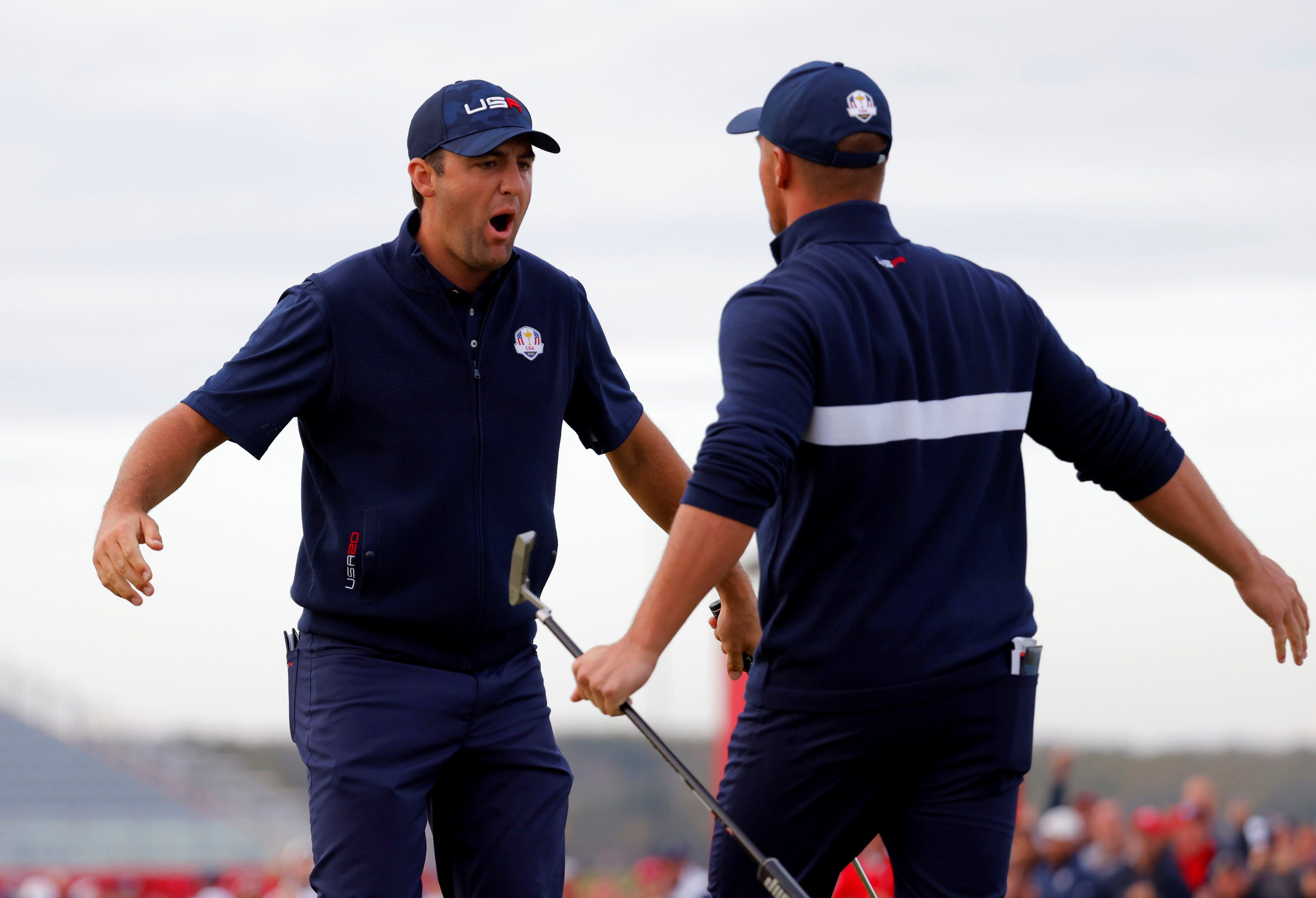 Golf - The 2020 Ryder Cup - Whistling Straits, Sheboygan, Wisconsin, U.S. - September 25, 2021 Team USA's Scottie Scheffler reacts with Team USA's Bryson DeChambeau after holing his putt on the 15th green to win the hole during the Four-balls REUTERS/Mike Segar     TPX IMAGES OF THE DAY