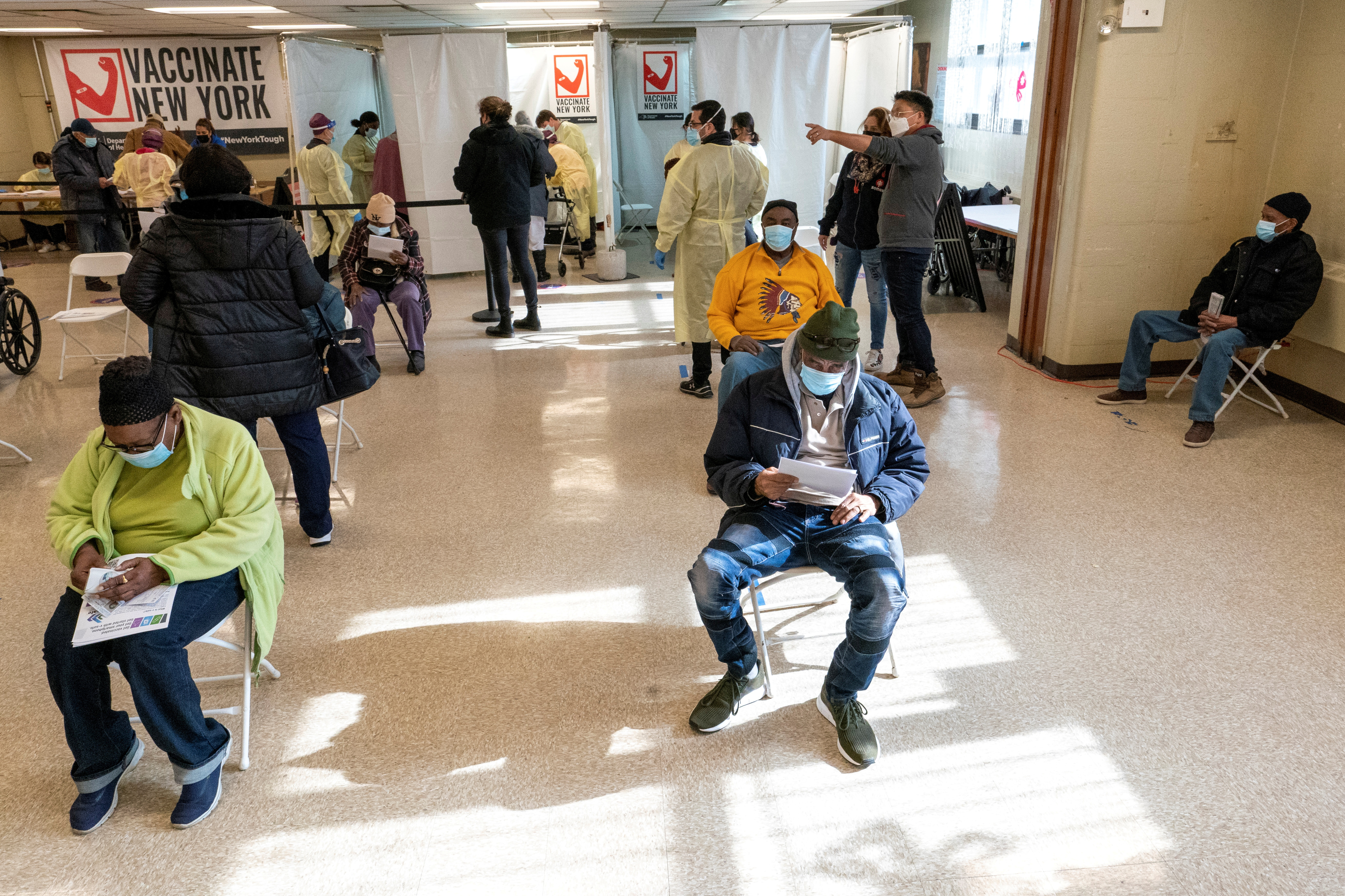 Residents of William Reid Apartments rest for a few minutes after receiving the first dose of the COVID-19 vaccine at a pop-up vaccination site in the NYCHA housing complex in Brooklyn, New York City, U.S., January 23, 2021. Mary Altaffer/Pool via REUTERS