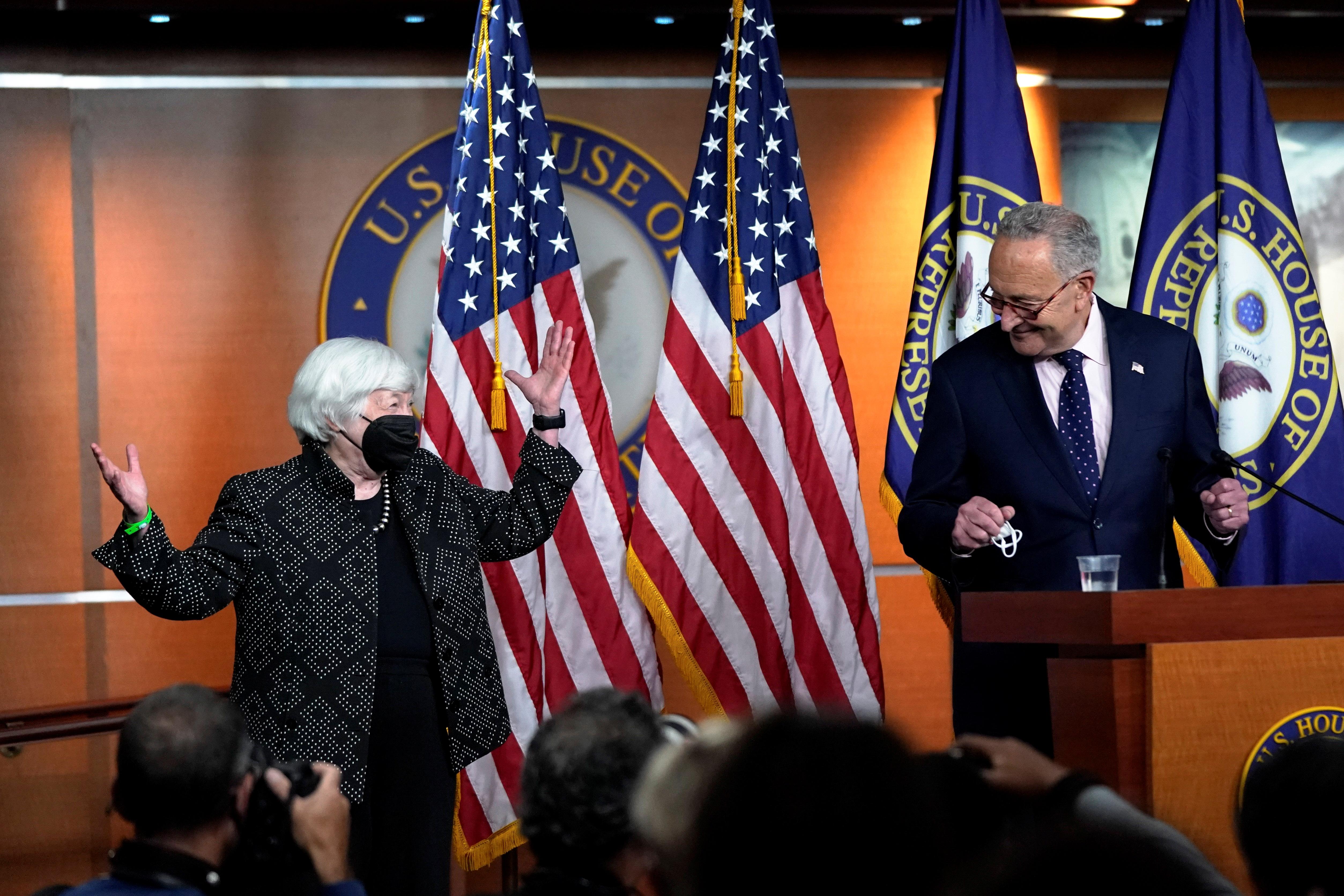 Treasury Secretary Janet Yellen gestures as Senate Majority Leader Chuck Schumer makes a brief statement before the start of House Speaker Nancy Pelosi's weekly news conference on Capitol Hill in Washington, U.S., September 23, 2021. REUTERS/Elizabeth Frantz
