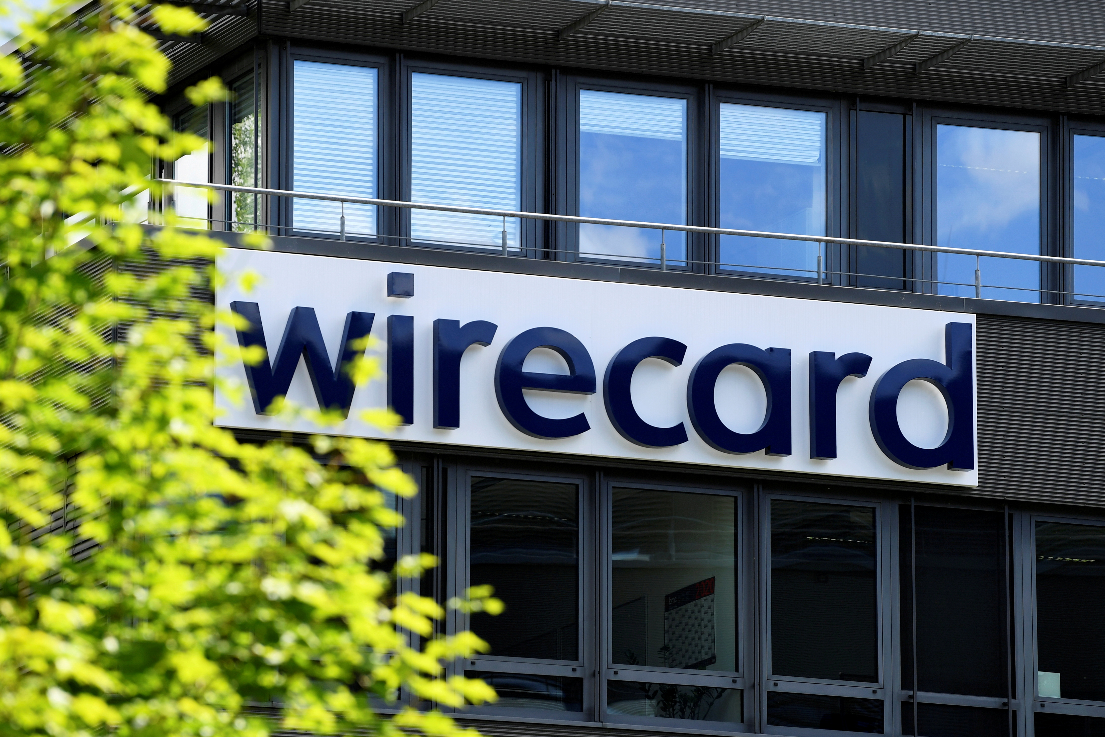 The logo of Wirecard AG is pictured at its headquarters in Aschheim, near Munich, Germany, July 1, 2020. REUTERS/Andreas Gebert/File Photo