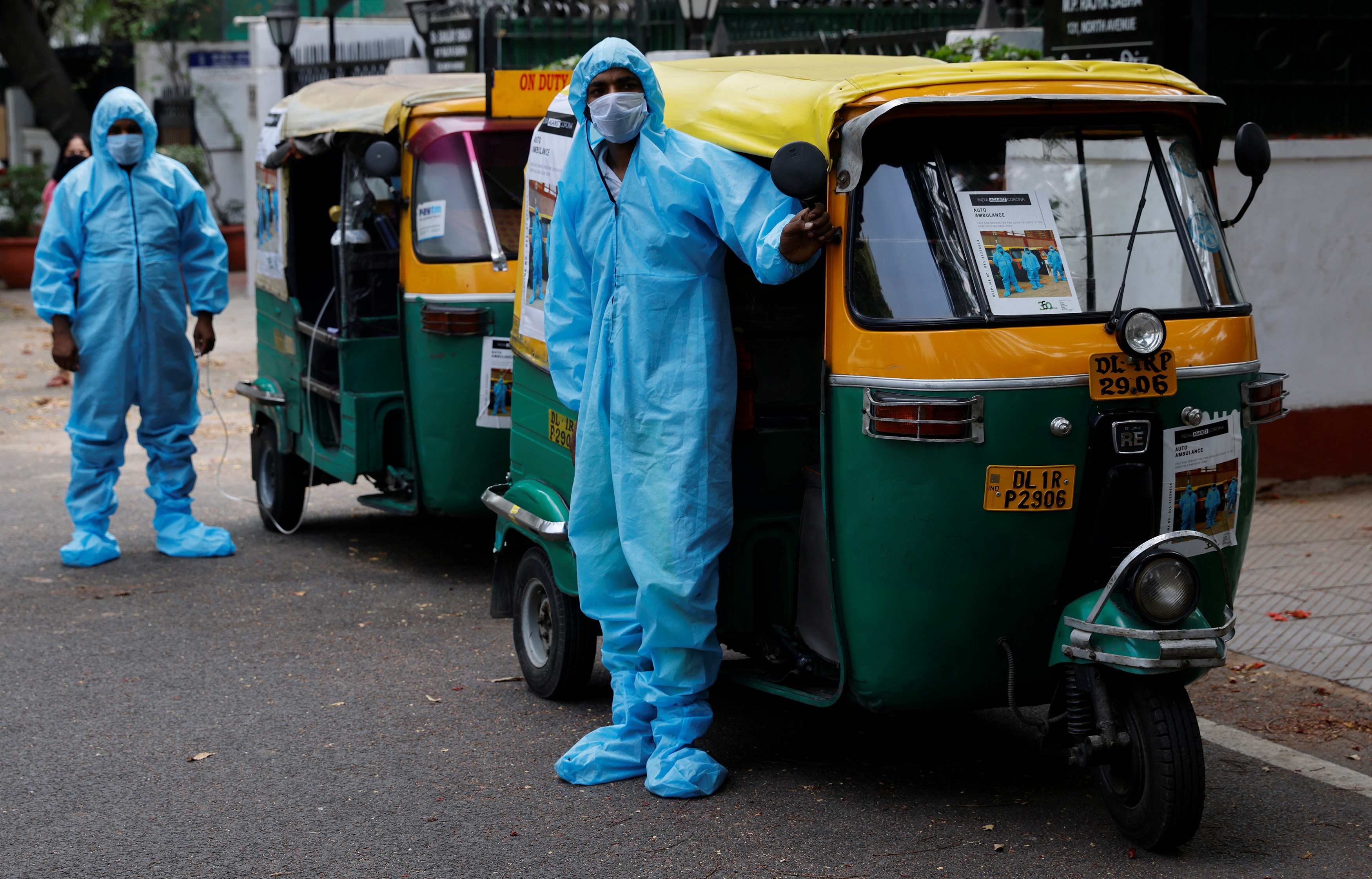 Drivers stand near auto rickshaw ambulances, prepared to transfer people suffering from the coronavirus disease (COVID-19) and their relatives for free, in New Delhi, India May 5, 2021.   REUTERS/Adnan Abidi