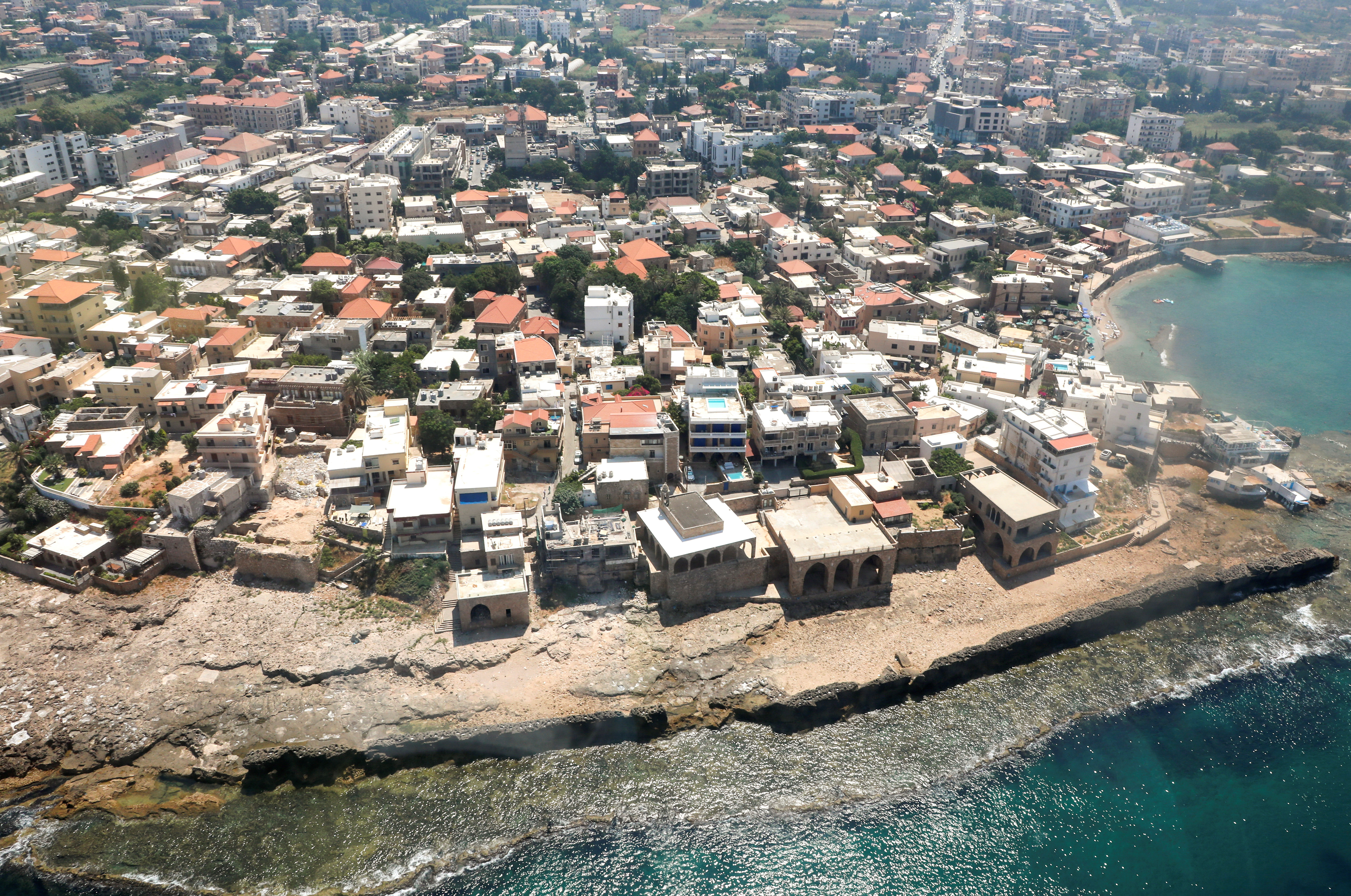 An aerial view shows the coastal city of Batroun during a tour by the Lebanese air force in Batroun, Lebanon July 8, 2021. REUTERS/Mohamed Azakir