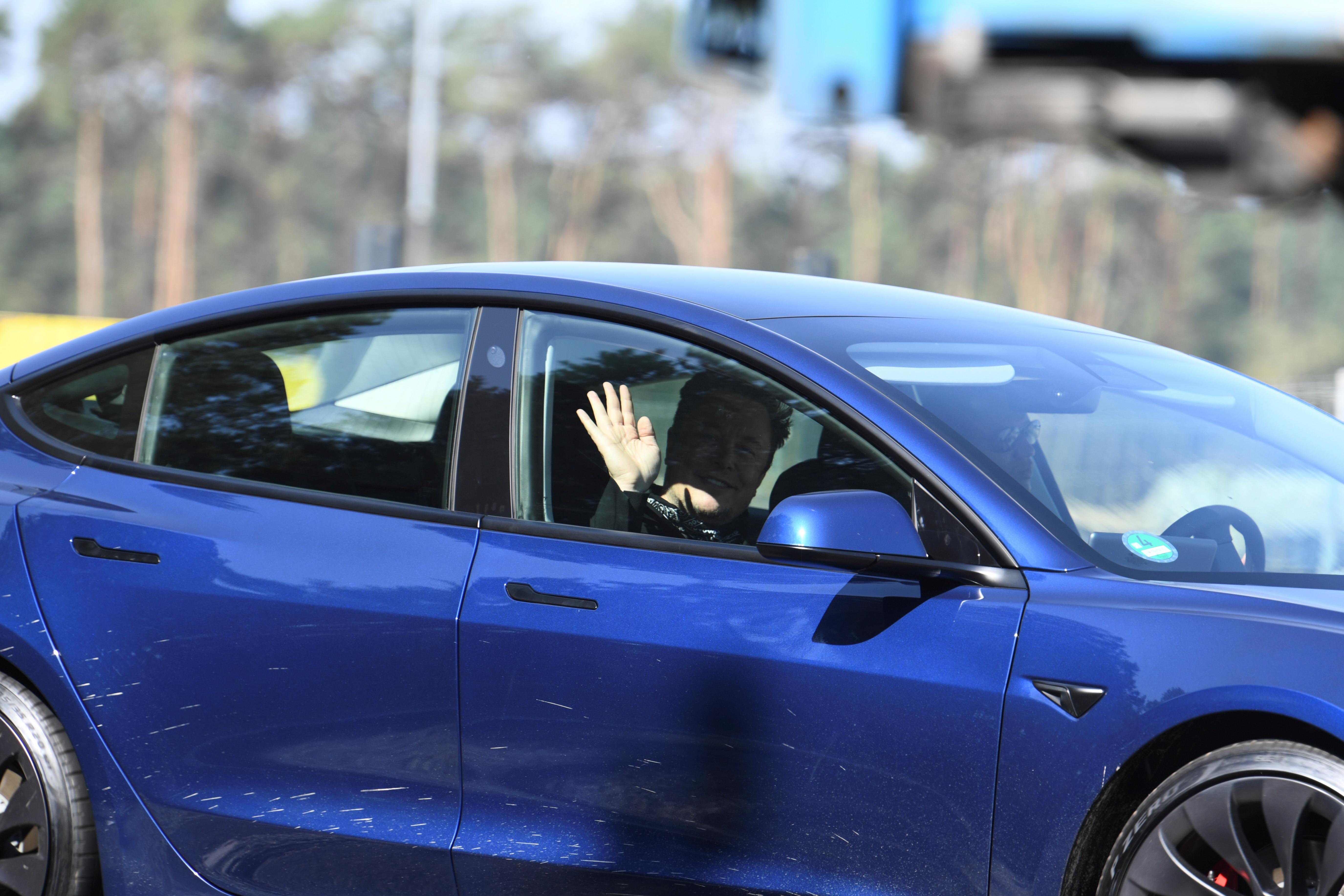 Tesla CEO Elon Musk gestures as he arrives at the construction site of Tesla's Gigafactory in Gruenheide near Berlin, Germany, August 13, 2021.  REUTERS/Annegret Hilse