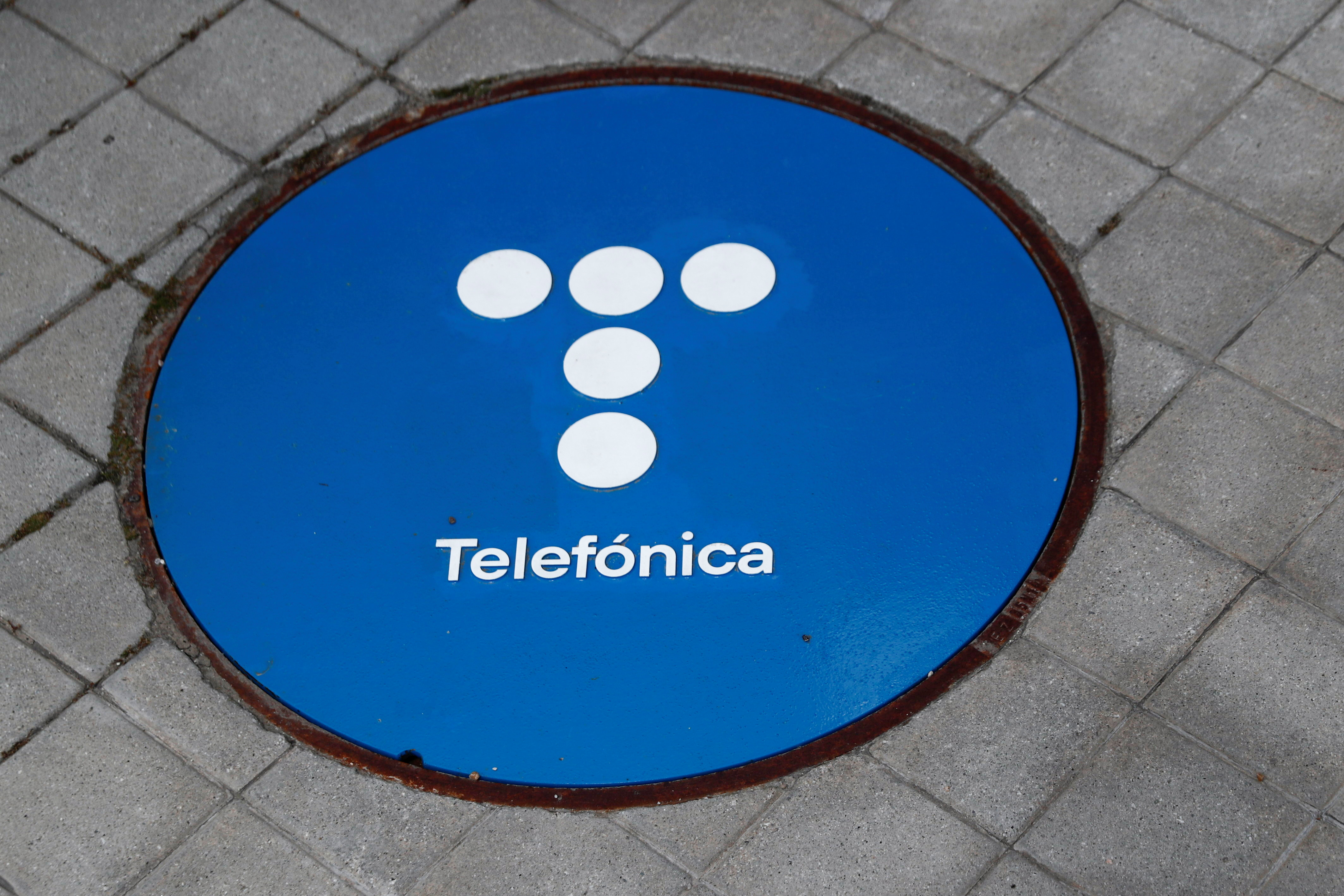 The logo of Spanish Telecom company Telefonica is seen on a sewage cover outside its headquarters in Madrid, Spain, May 12, 2021. REUTERS/Sergio Perez