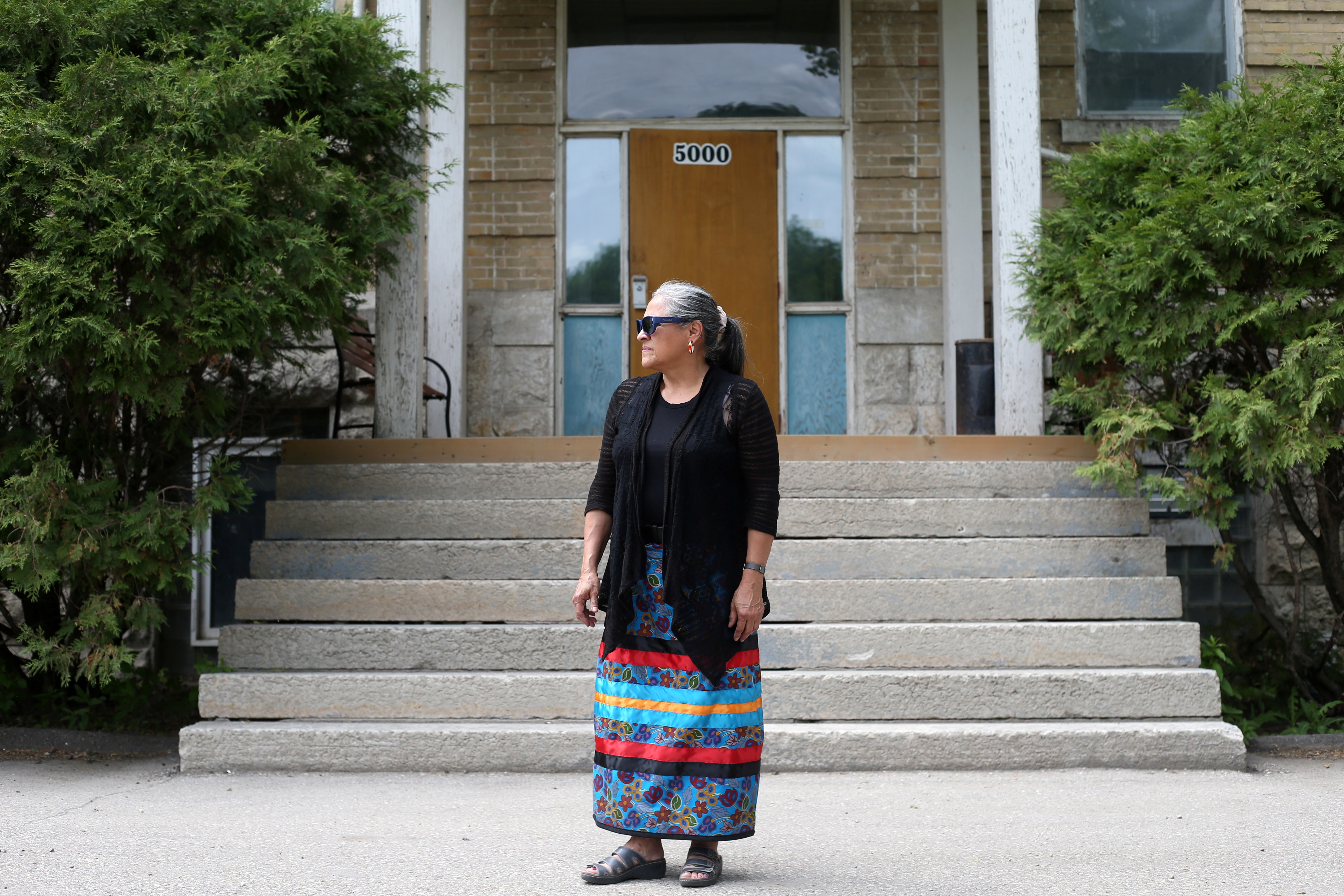 Lorraine Daniels, executive director of The Indian Residential School Museum of Canada, poses at the former Portage La Prairie Indian Residential School in Portage La Prairie, Manitoba, Canada, June 8, 2021. Picture taken June 8, 2021. REUTERS/Shannon VanRaes