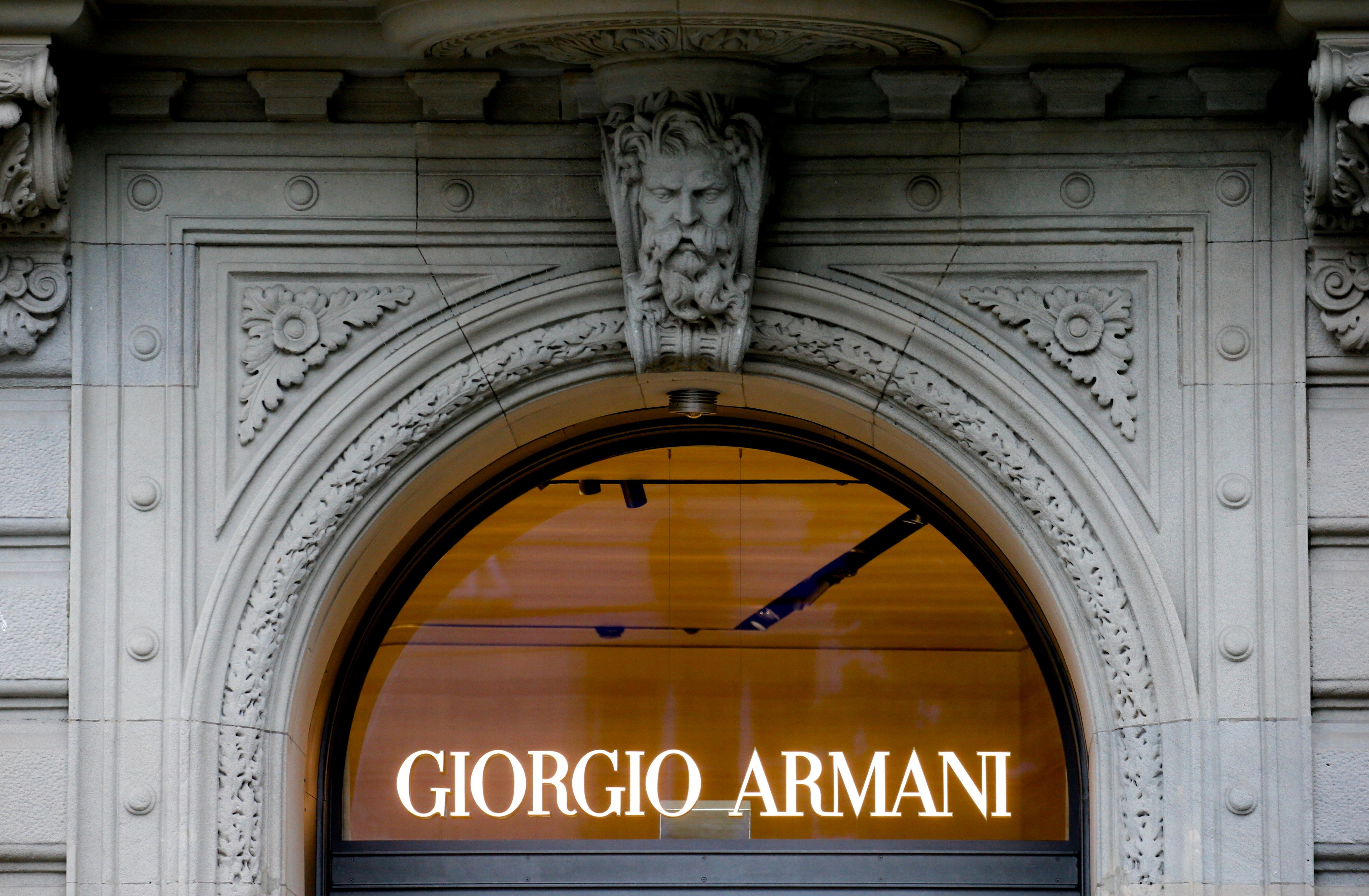 The logo of Italian fashion company Giorgio Armani is seen at a shop in Zurich, Switzerland July 8, 2021.  REUTERS/Arnd Wiegmann/File Photo