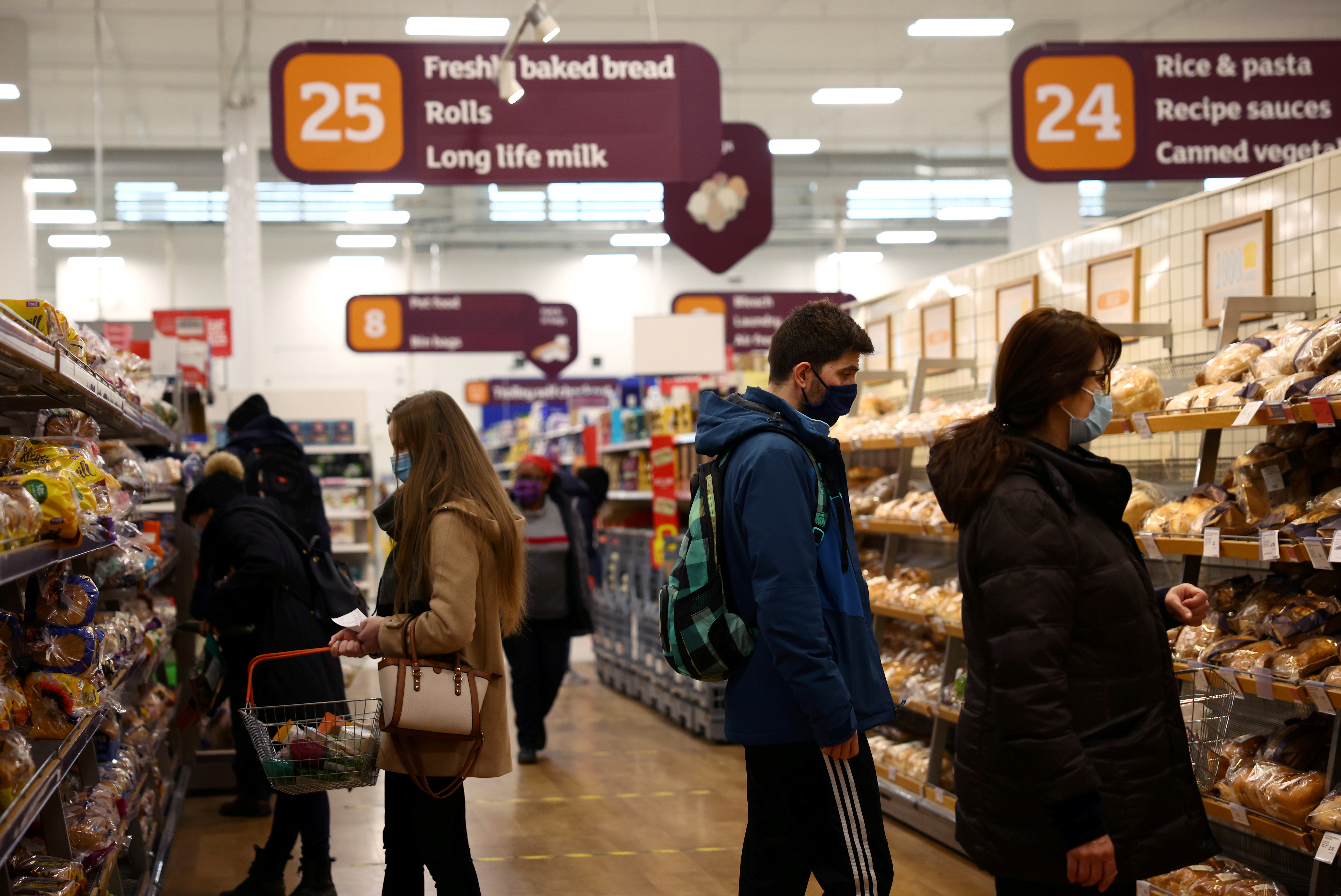 Shoppers look at bread in a Sainsbury's supermarket, amid the coronavirus disease (COVID-19) outbreak, in London, Britain January 12, 2021. REUTERS/Henry Nicholls/File Photo
